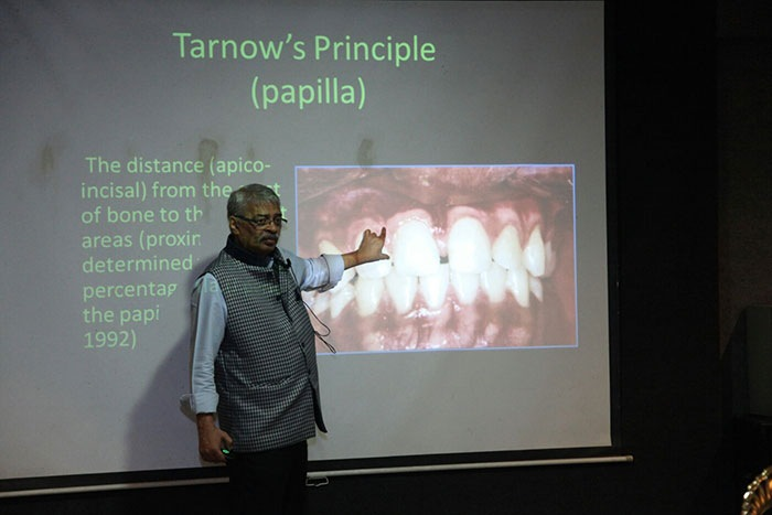 Senior Dr. Standing on Seminar stage at Dental Implant Clinic by Dental Implant Lucknow