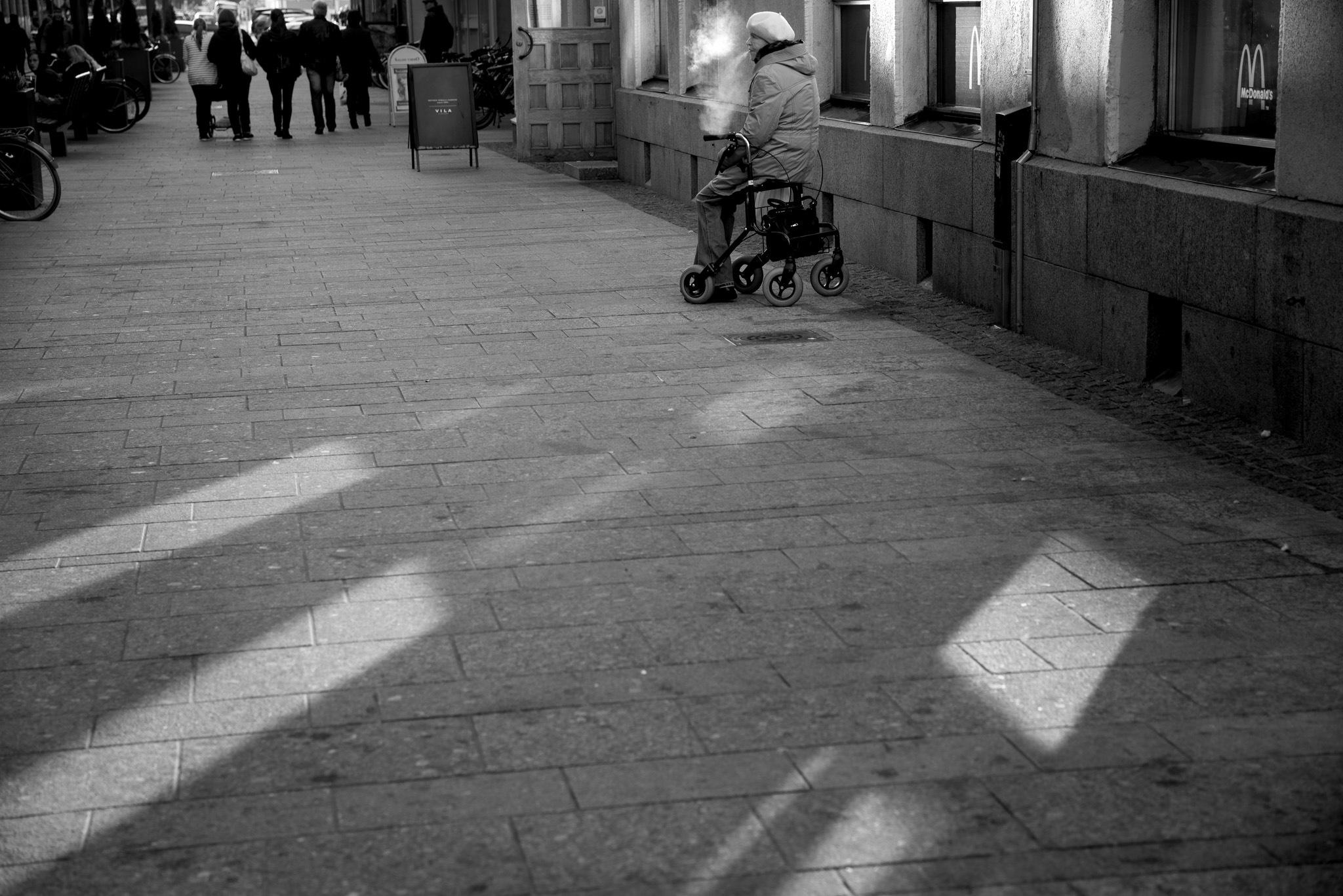 Lady smokes a cigarette by Jaani Föhr