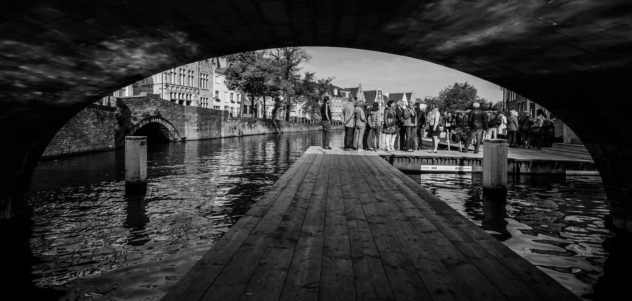 Tourist on Bruges canals by Noel Pauwaert