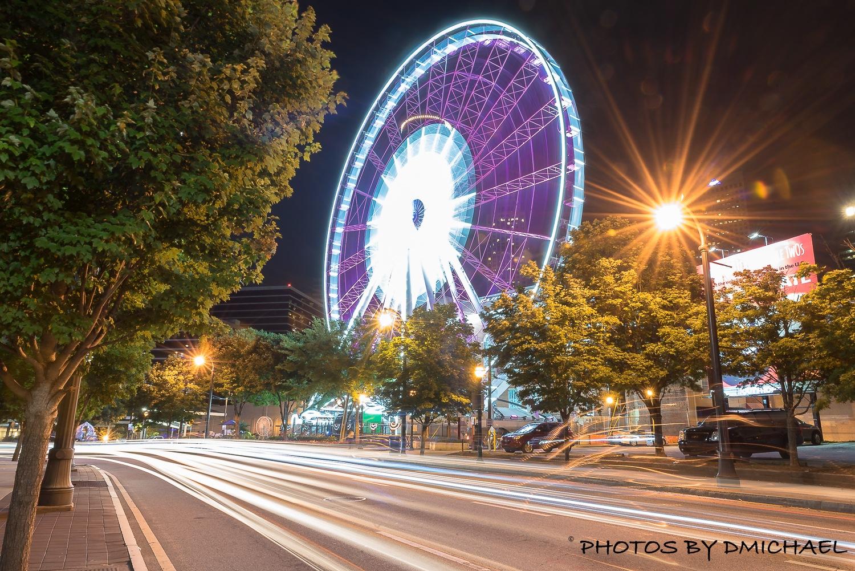 Sky view Ferris wheel  by Devine Michael Clayton