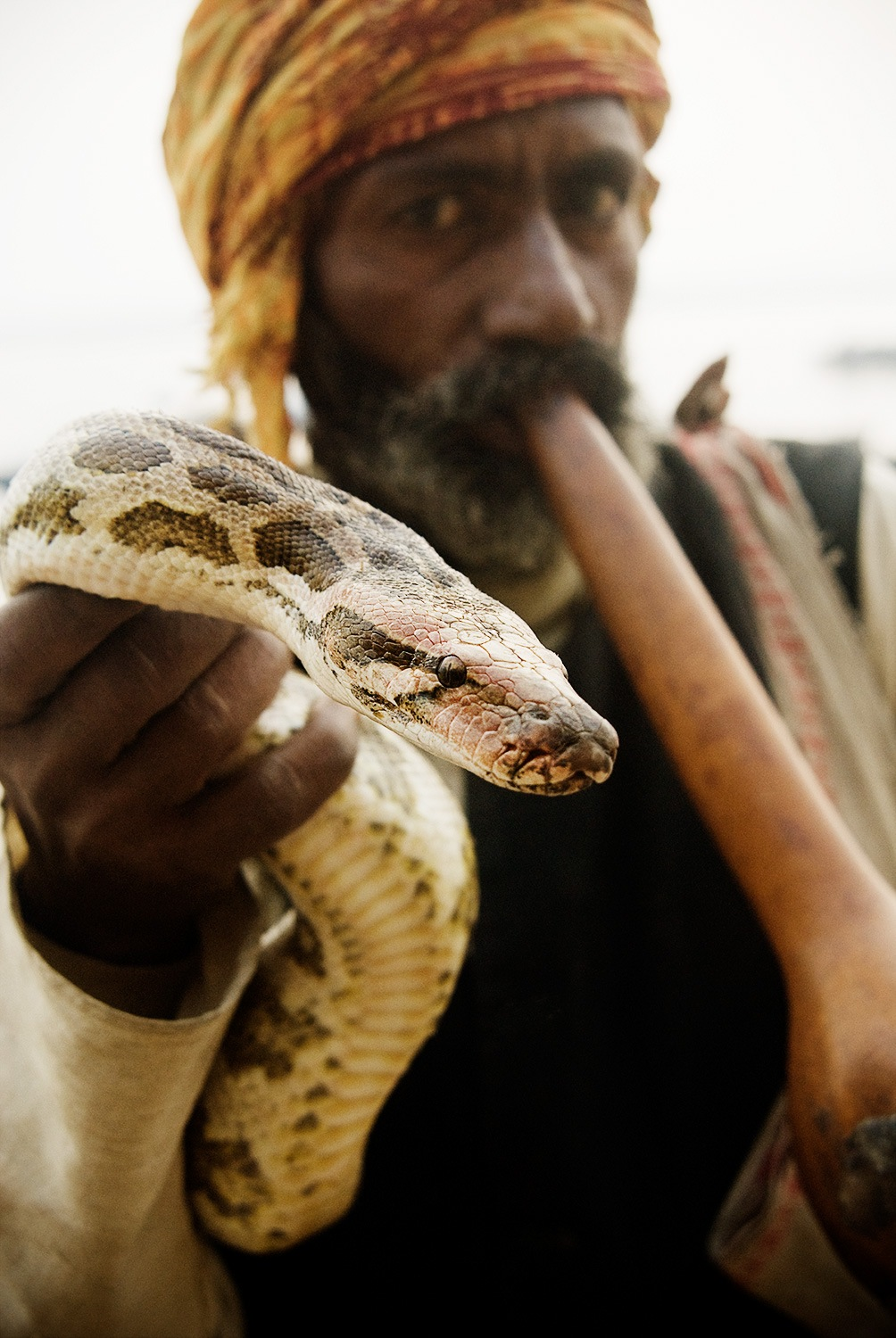 Snake Charmer in Varanasi by Michael Marquand