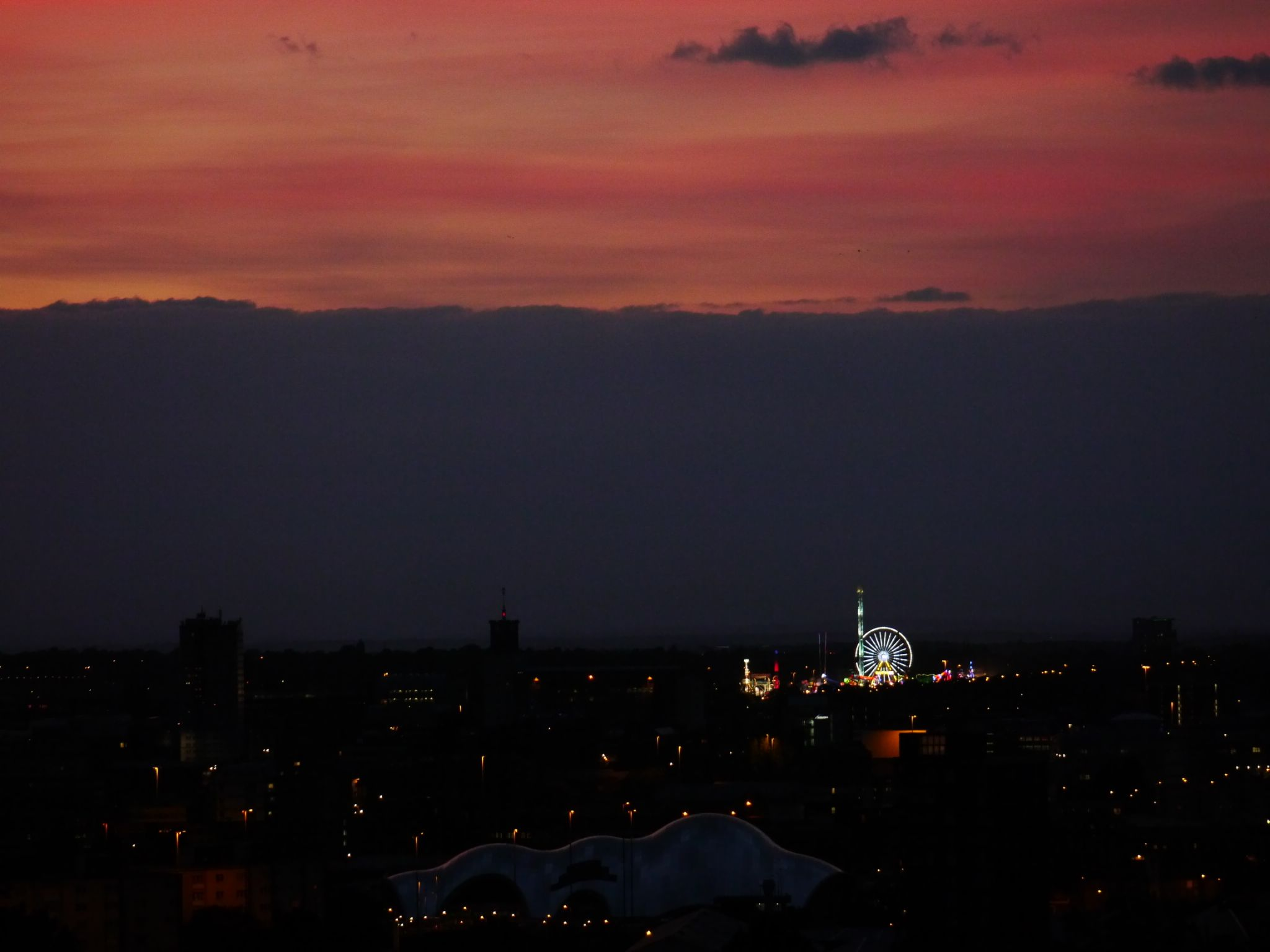 Sunset and the Hoppings funfair by Darren Turner