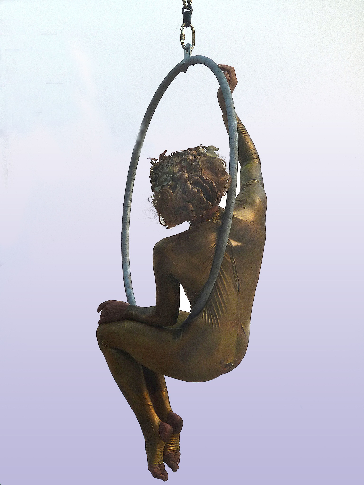Acrobats in gold at the Festival by Rebecca Danieli