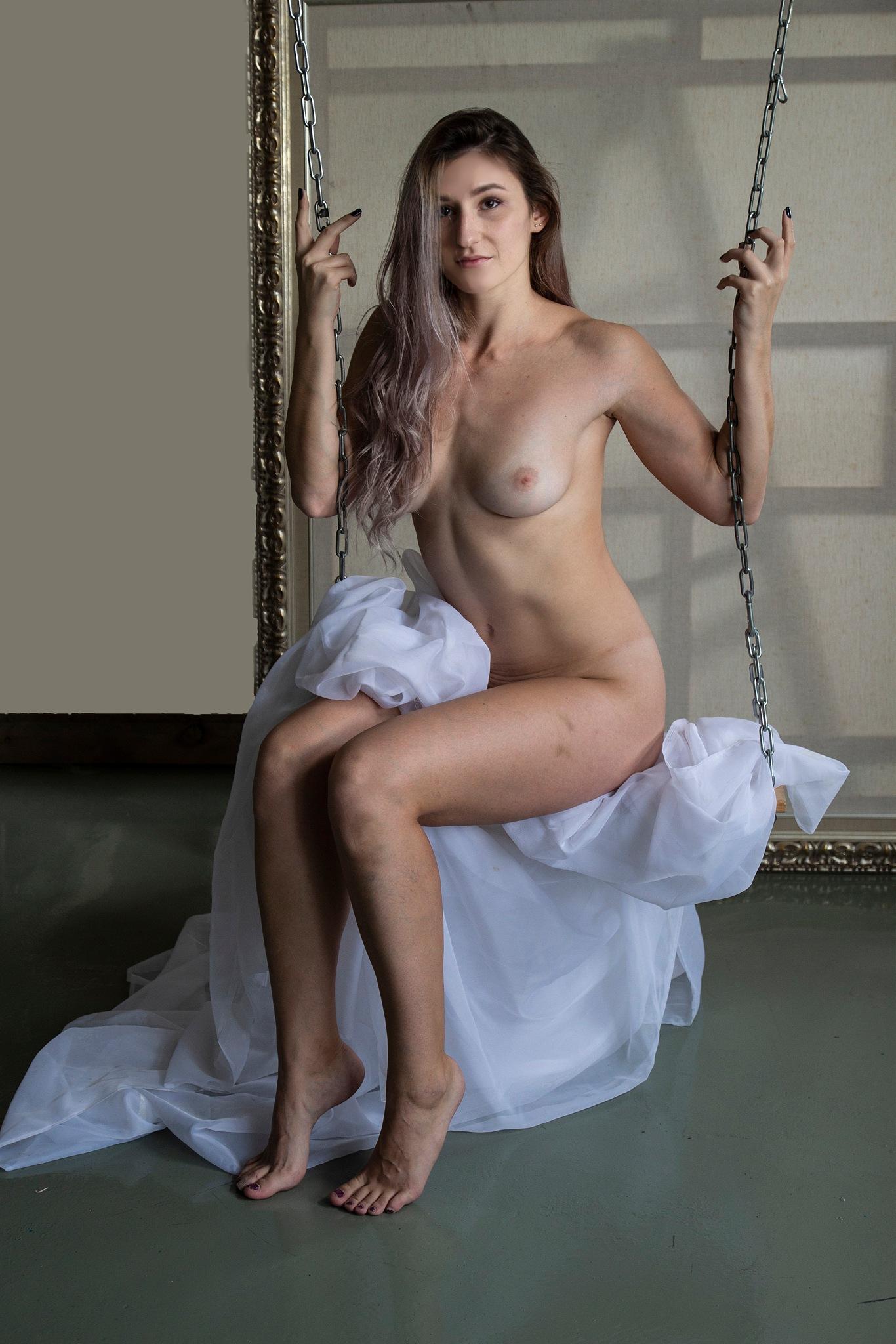 Tesia on the swing... by Rebecca Danieli