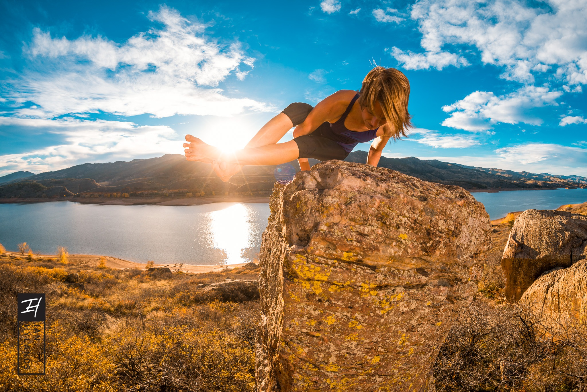 Andrea - Yoga on the Rock by Ian Hylands