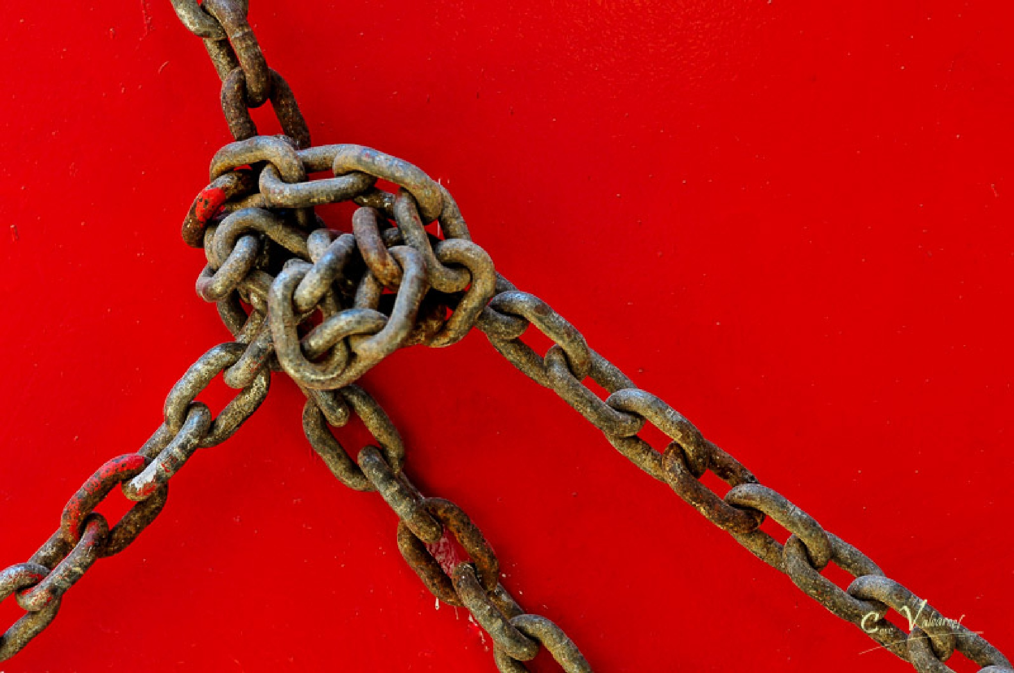 Chains over red by Cesc Valcarcel