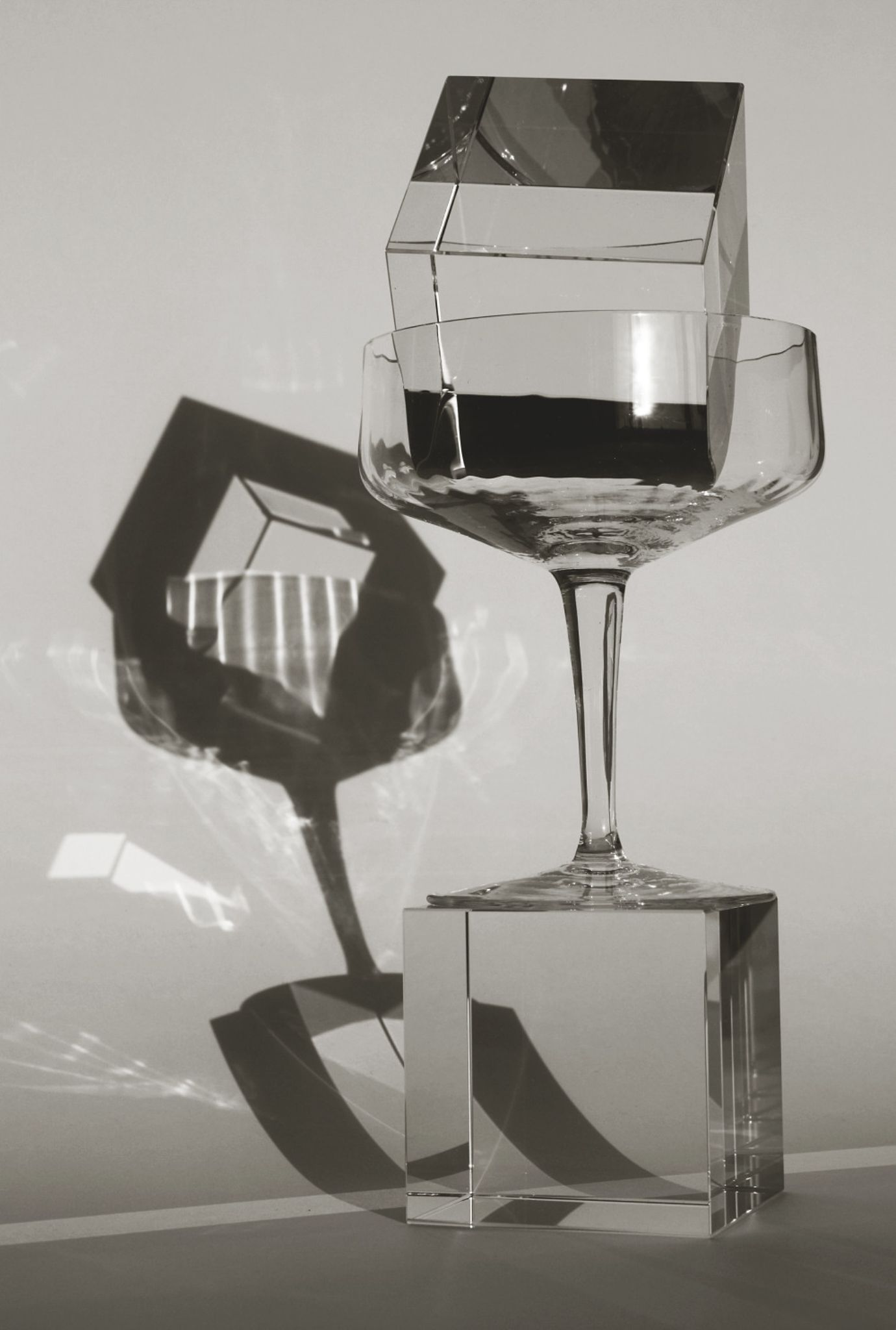 still life with a glass and a cube by Robert Zauer