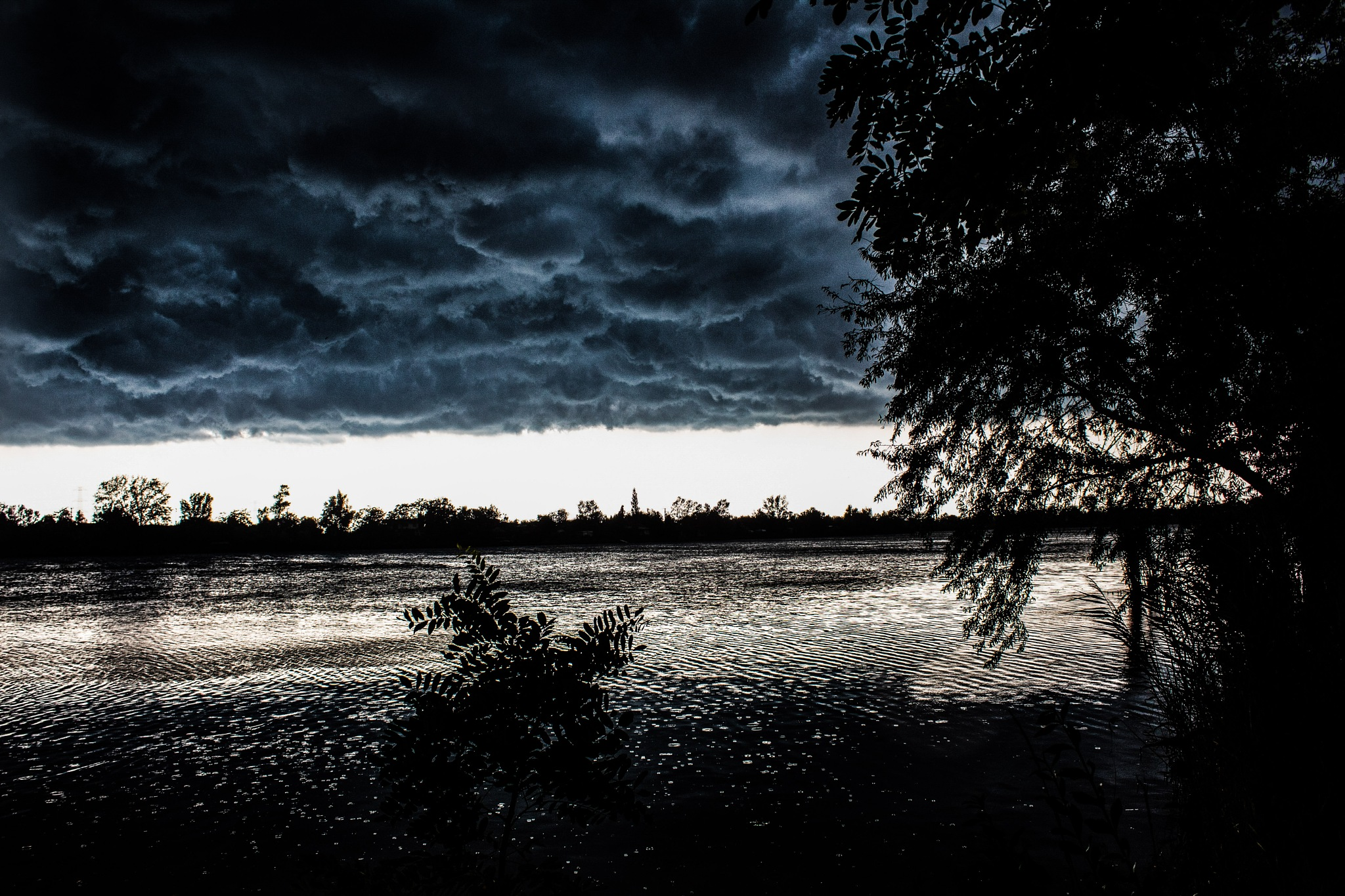 start the storm on the lakebeach noon. by Endre Vigh