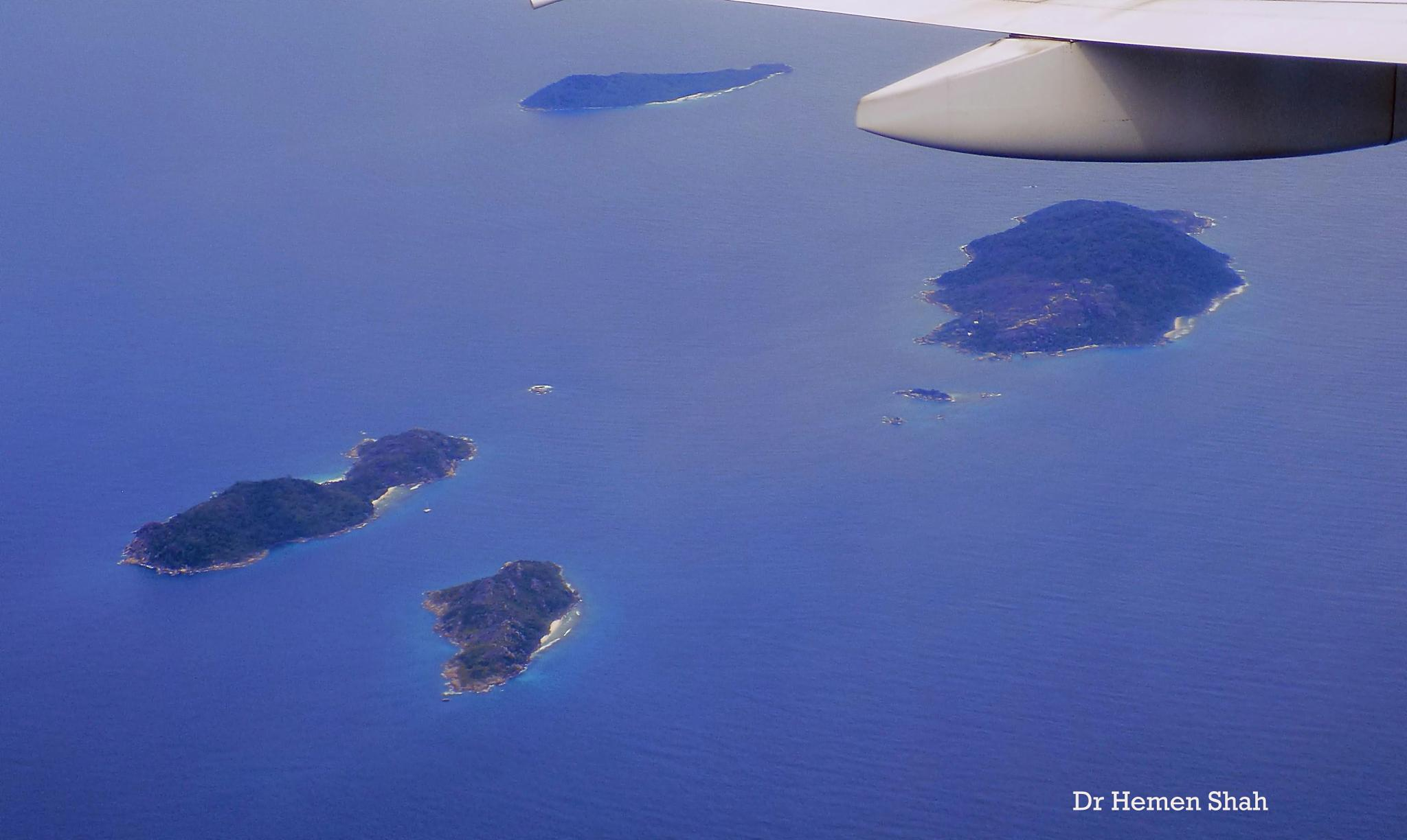 Isles of Seychelles captured from the flight with awesome colors of the sea. by Hemen