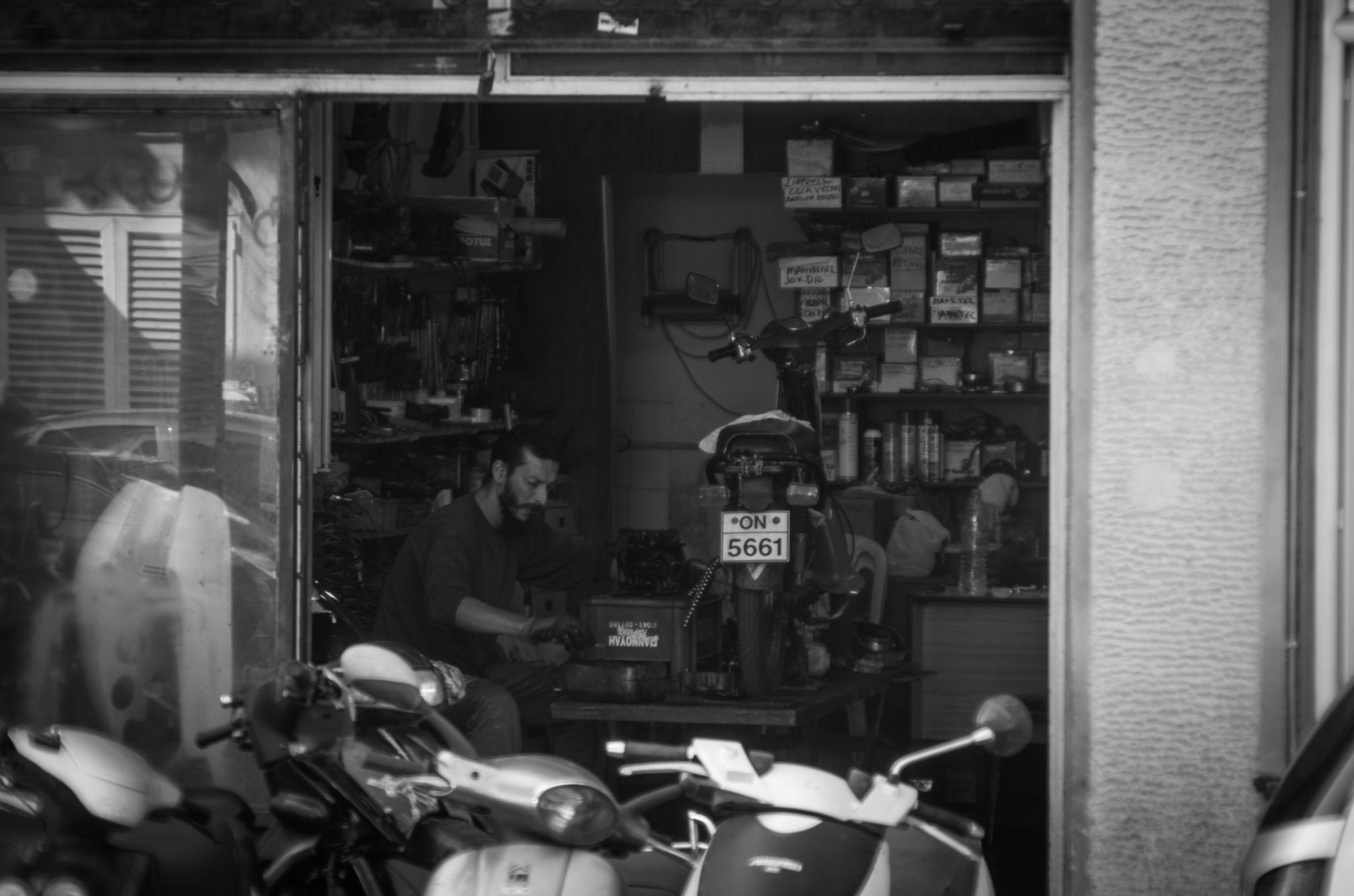 repairman in Saloniki  by Tomas Ferech