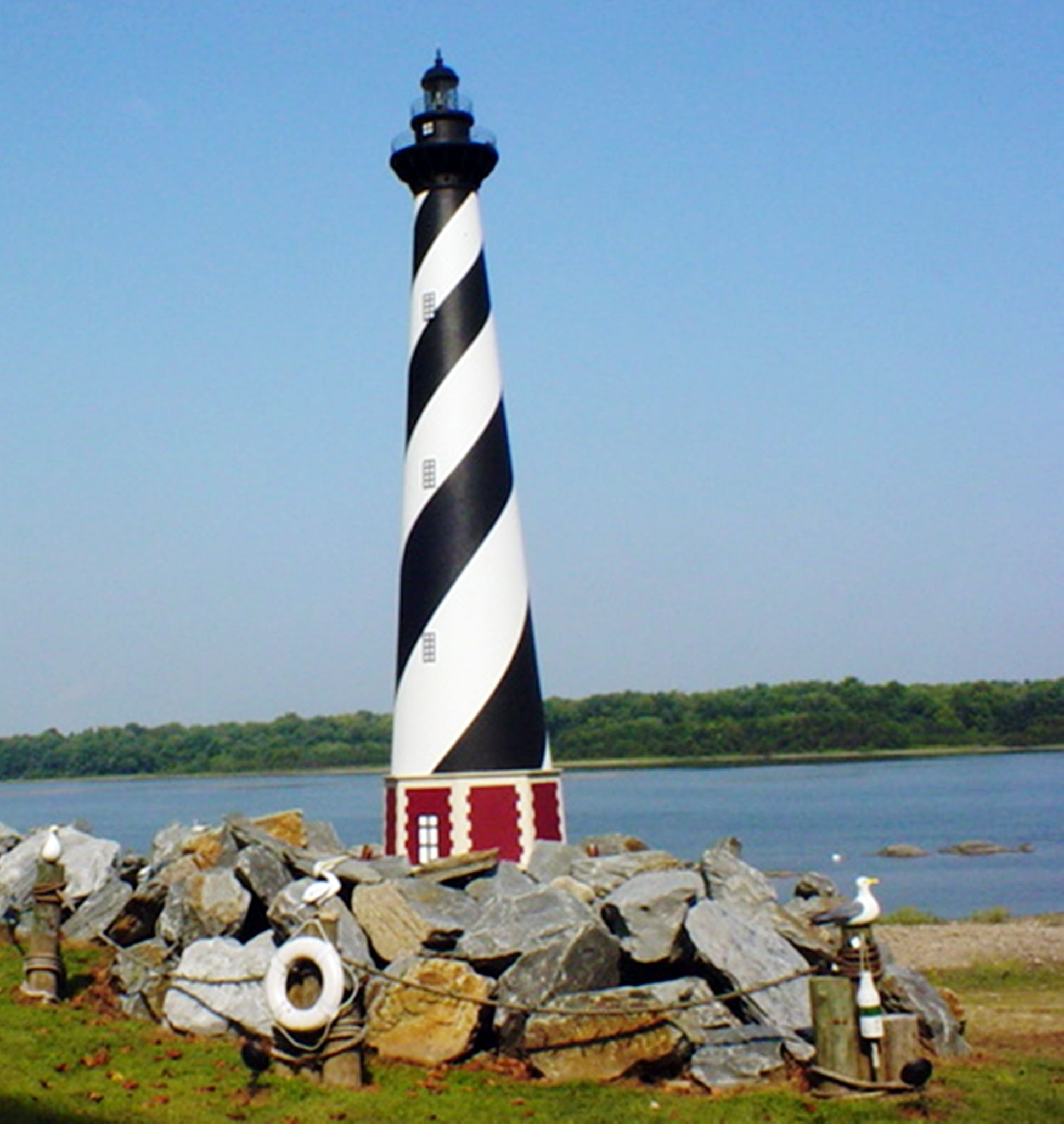 Light House by the River by John Benedick