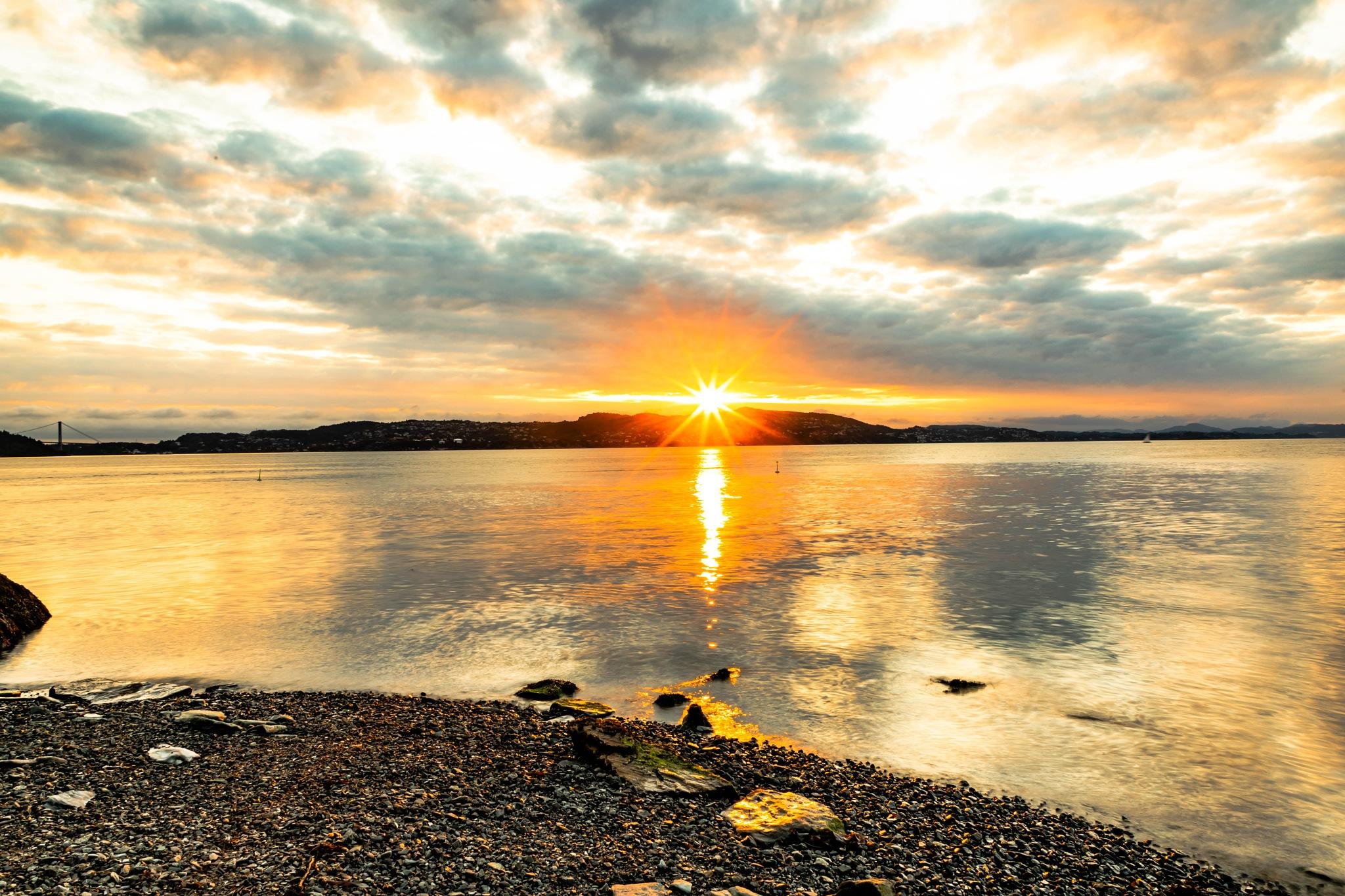 Sunset over the island by Svein Erik Andresen