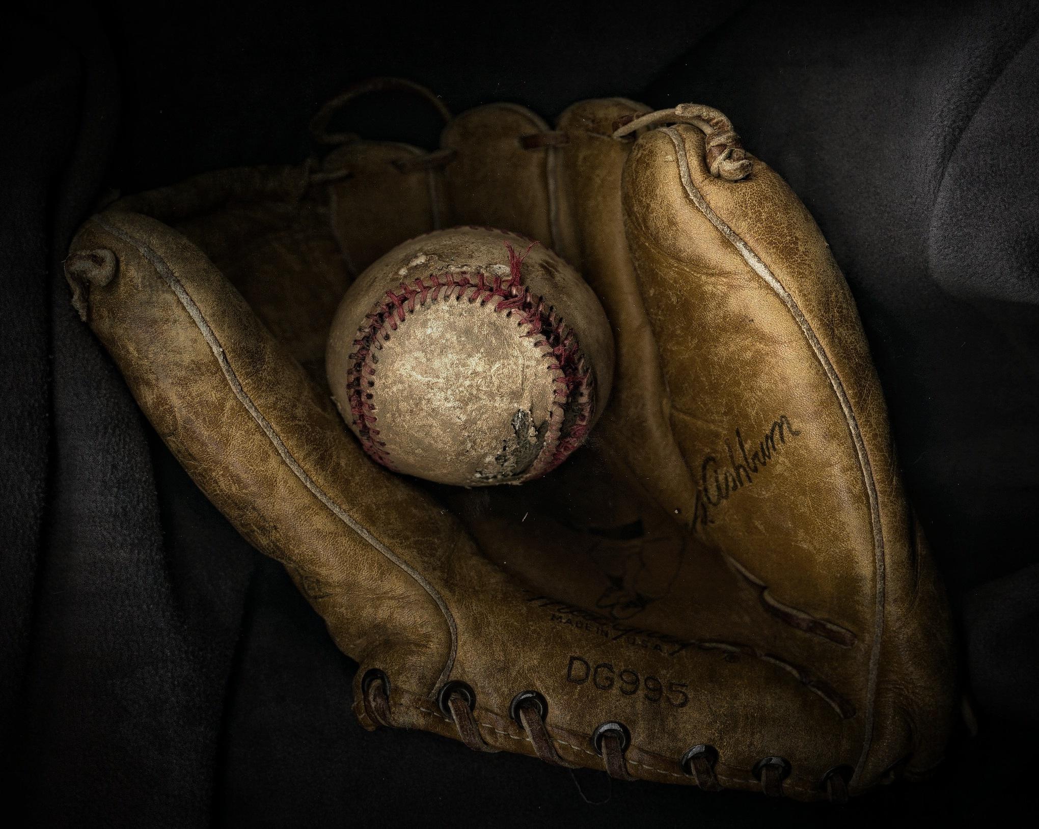 baseball and glove by Tony Kao
