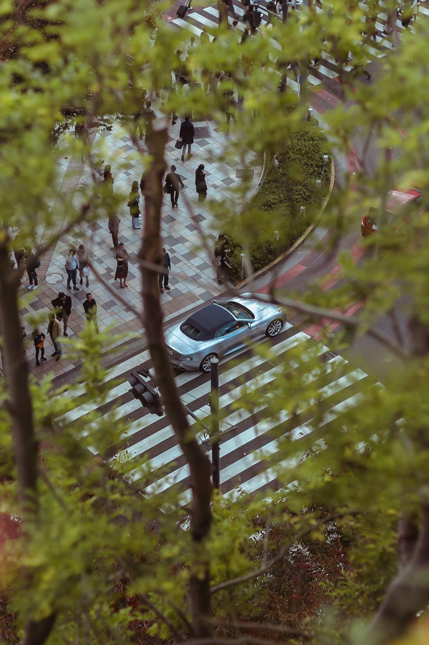 Aston Martin in the streets of Tokyo by Rabin Nuchtabek