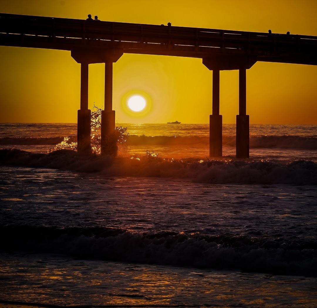 Ocean Pier Sunset  by Hughfoto