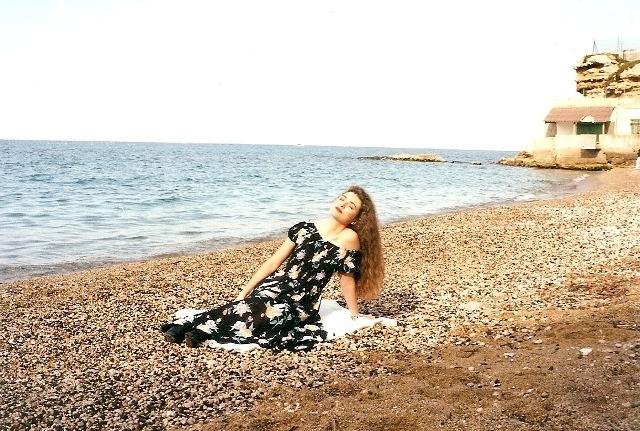 On the beach by Lisa Giraud Taylor