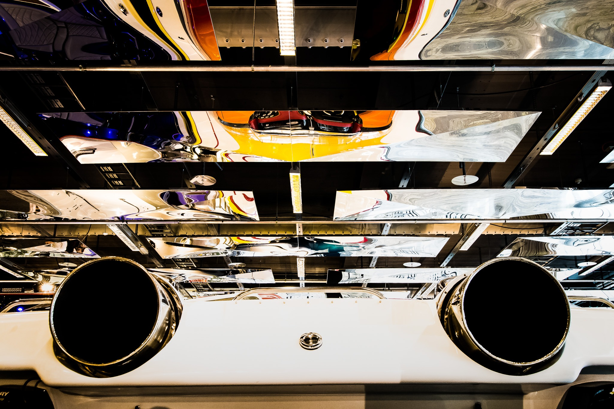 Exhaust pipe of a jet engine powered boat, while we see the boat is reflected in the ciling by Jonas Hermansson