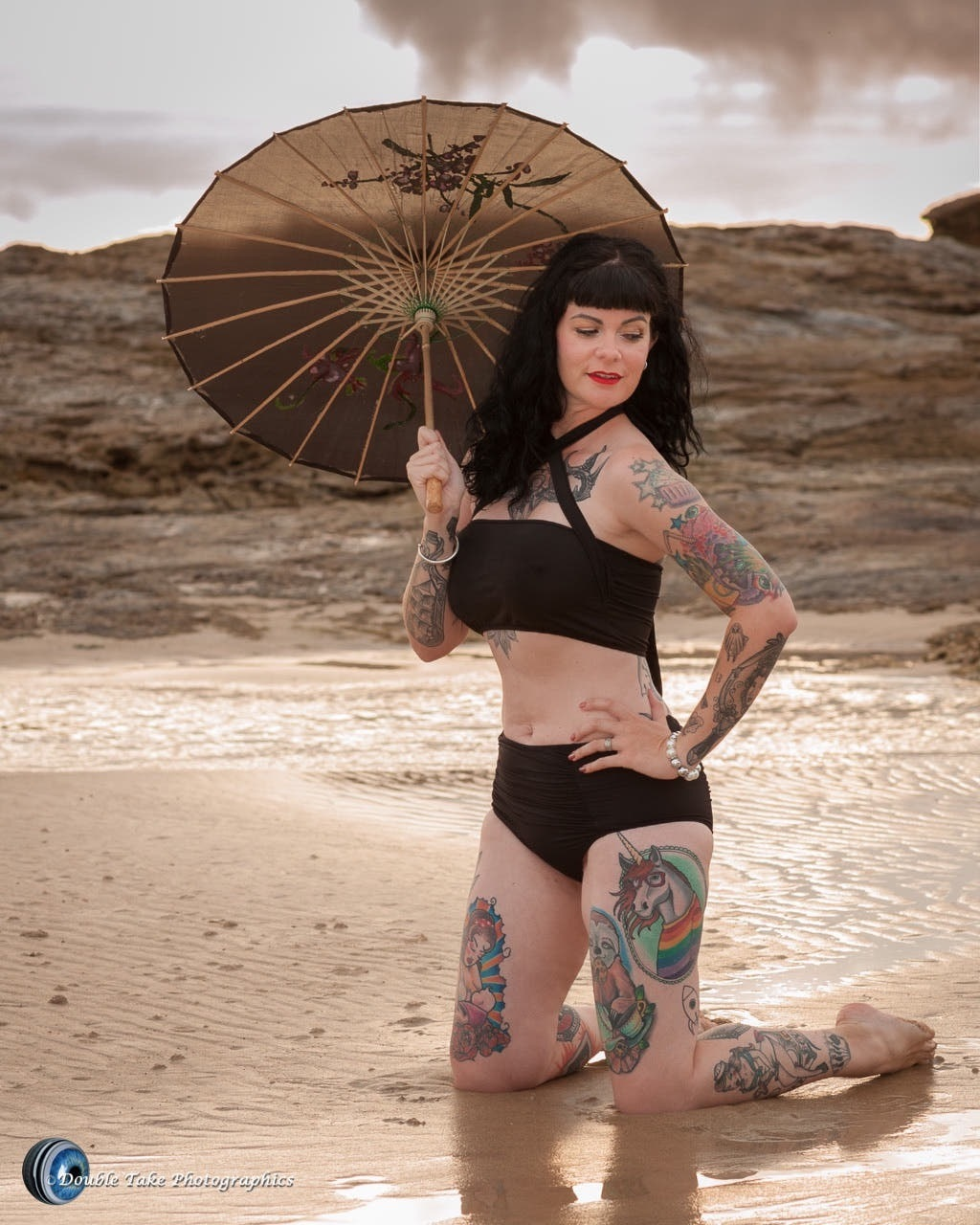 Kitty, the parasol and the unicorn  by Double Take Photographics