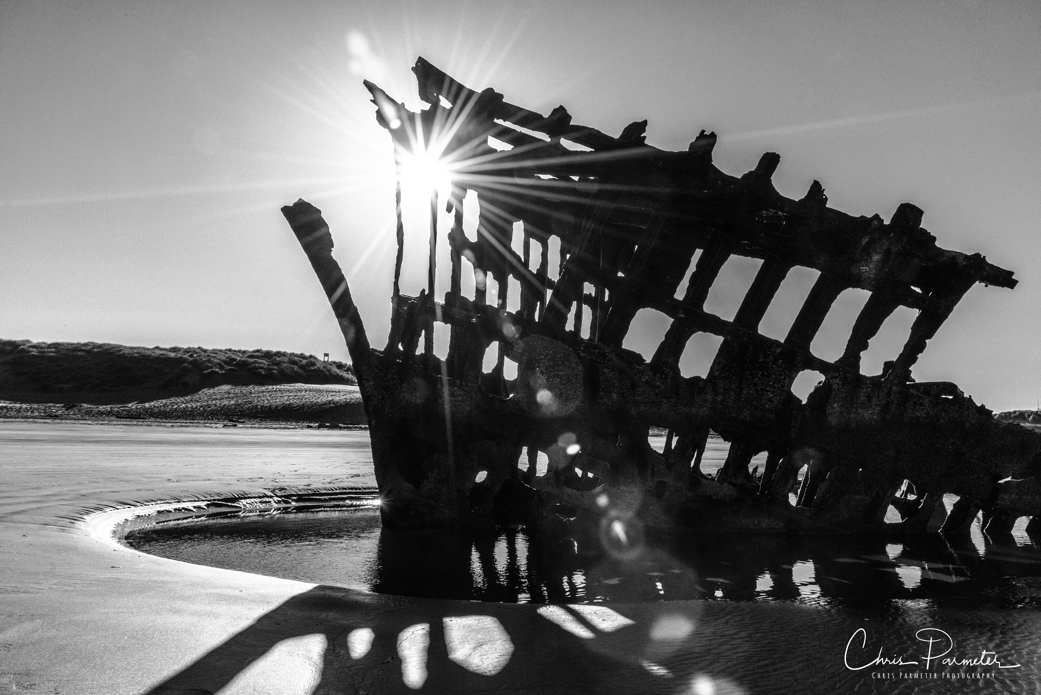Sunrise through the Wreck  by Wet Dog Studios