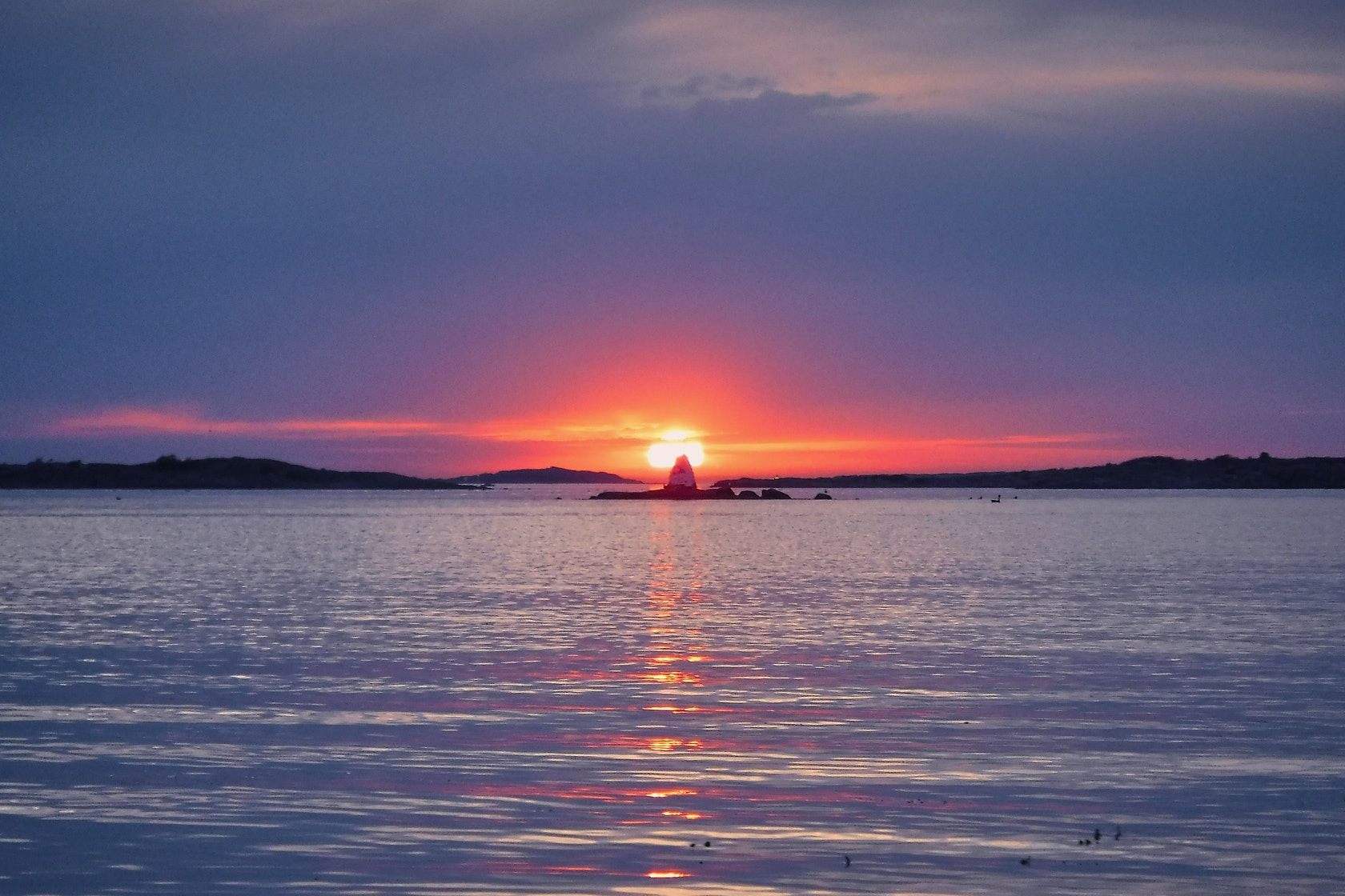 Sunset on the Swedish west coast.  by DDeninger