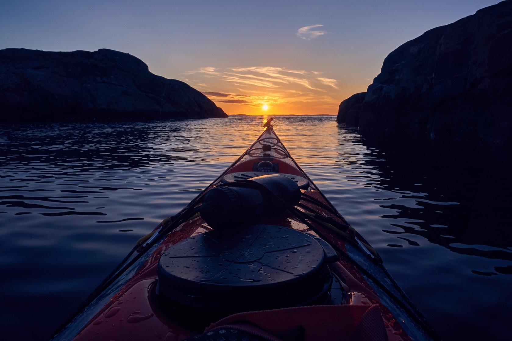 Sunset paddling on the Swedish west coast  by Kayak Photographer