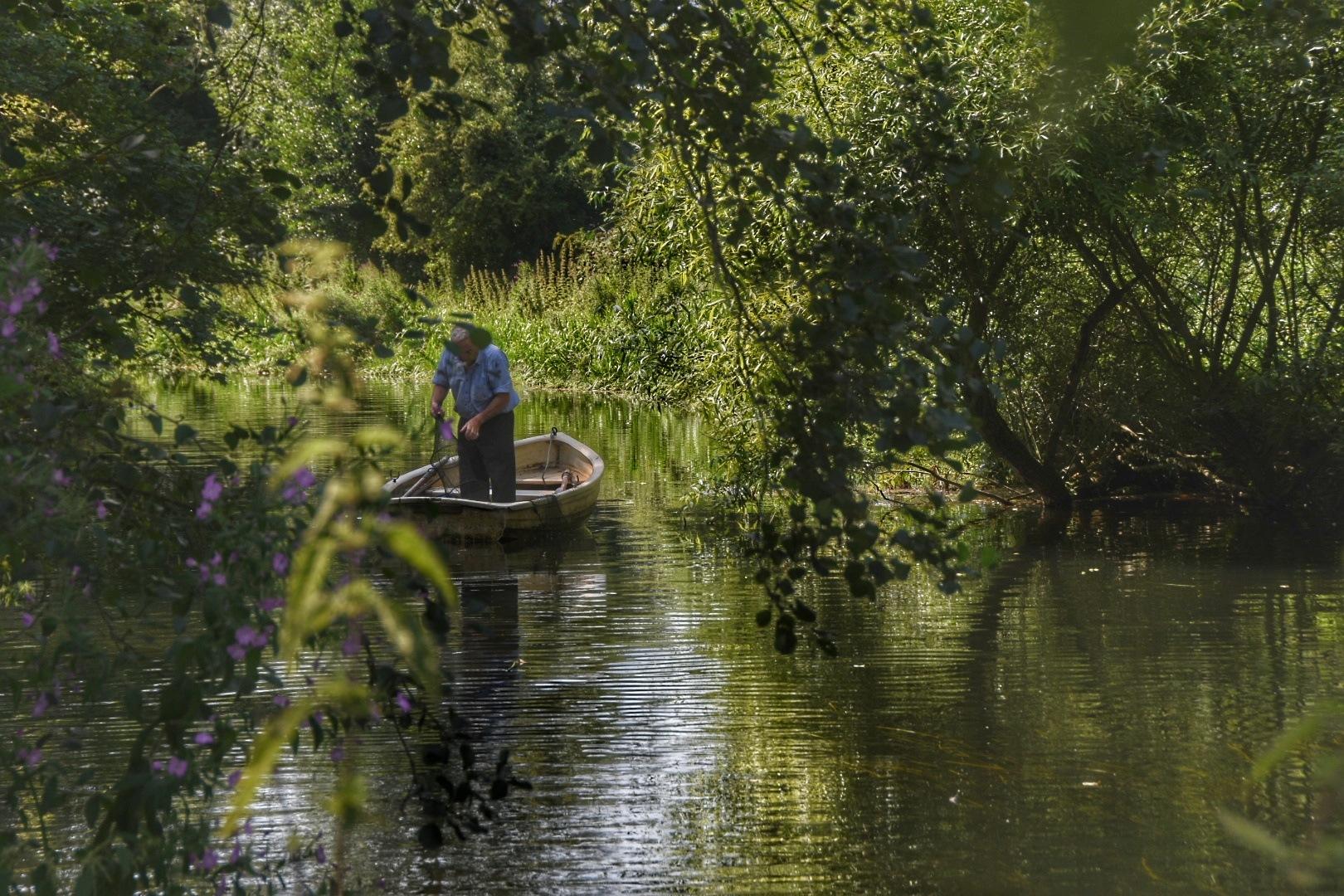 man in a small boat by David Starkey