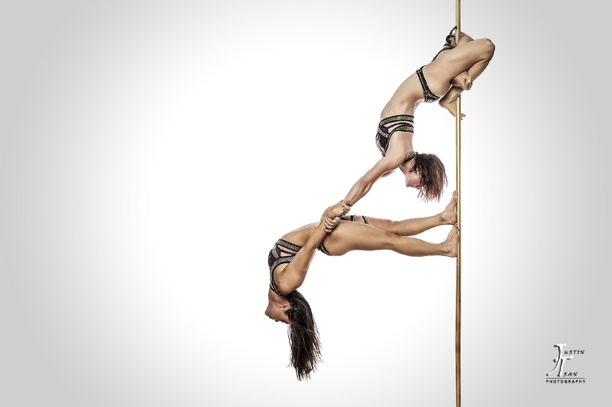 Photo in Sports #pole dance #pole dancing #pole dancers #doubles #justin tran #justin tran photography #sports #athletics #strength #flexible #models #wowom #women