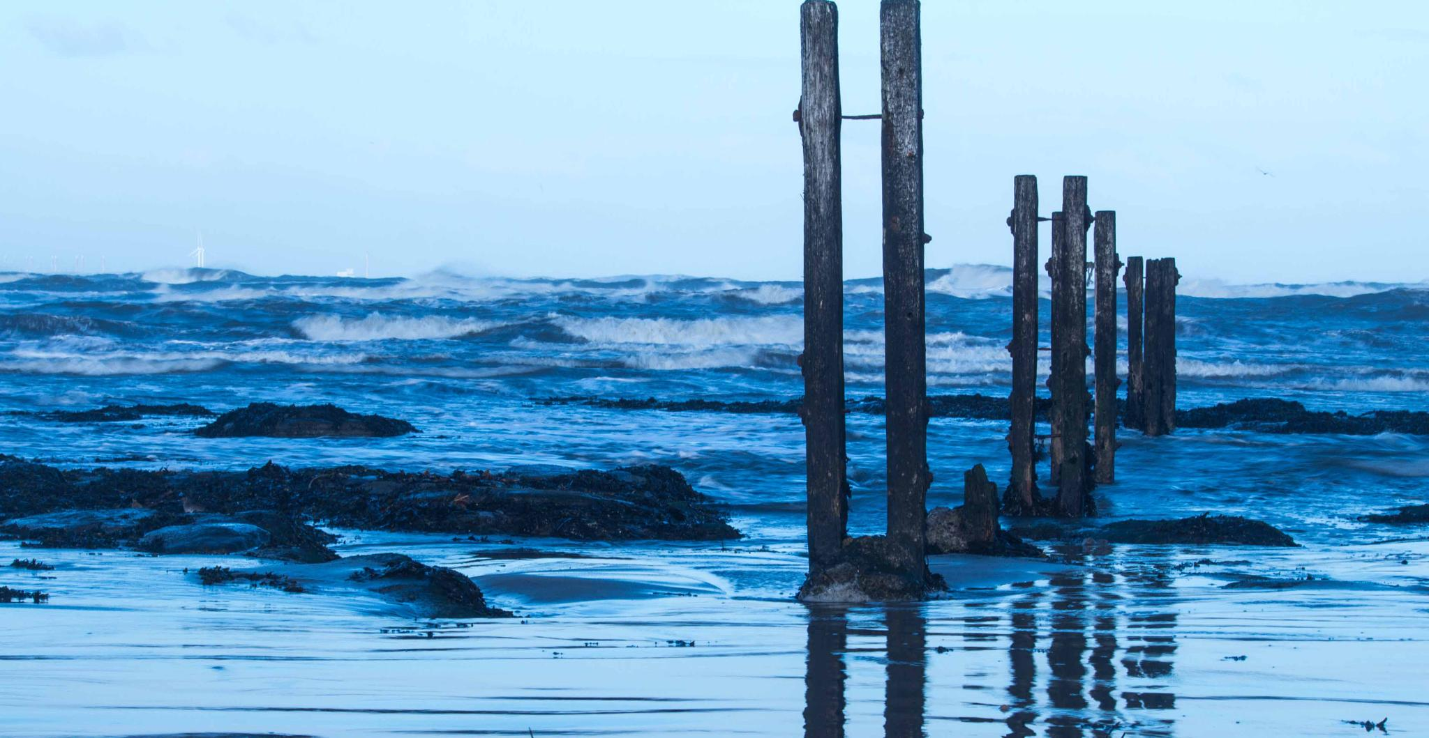 Battered Wooden Sea Defenses with Reflections, Blyth Beach by Mikey Holmes