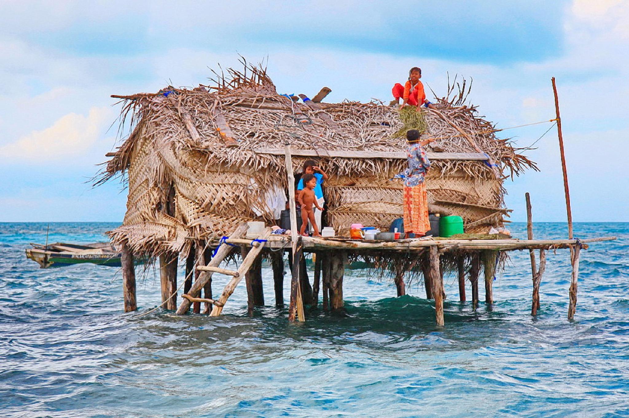 Photo in People #poor people #sea #house