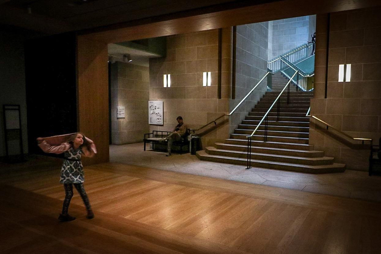 Girl dancing in museum by Doug Baker