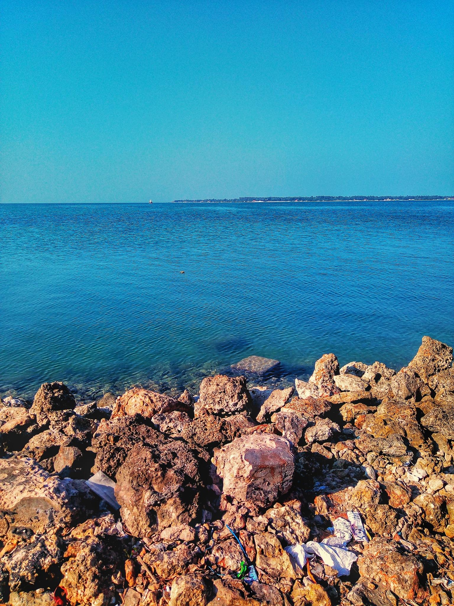 The sky, The Ocean & The Land by Aanjelo Salgado