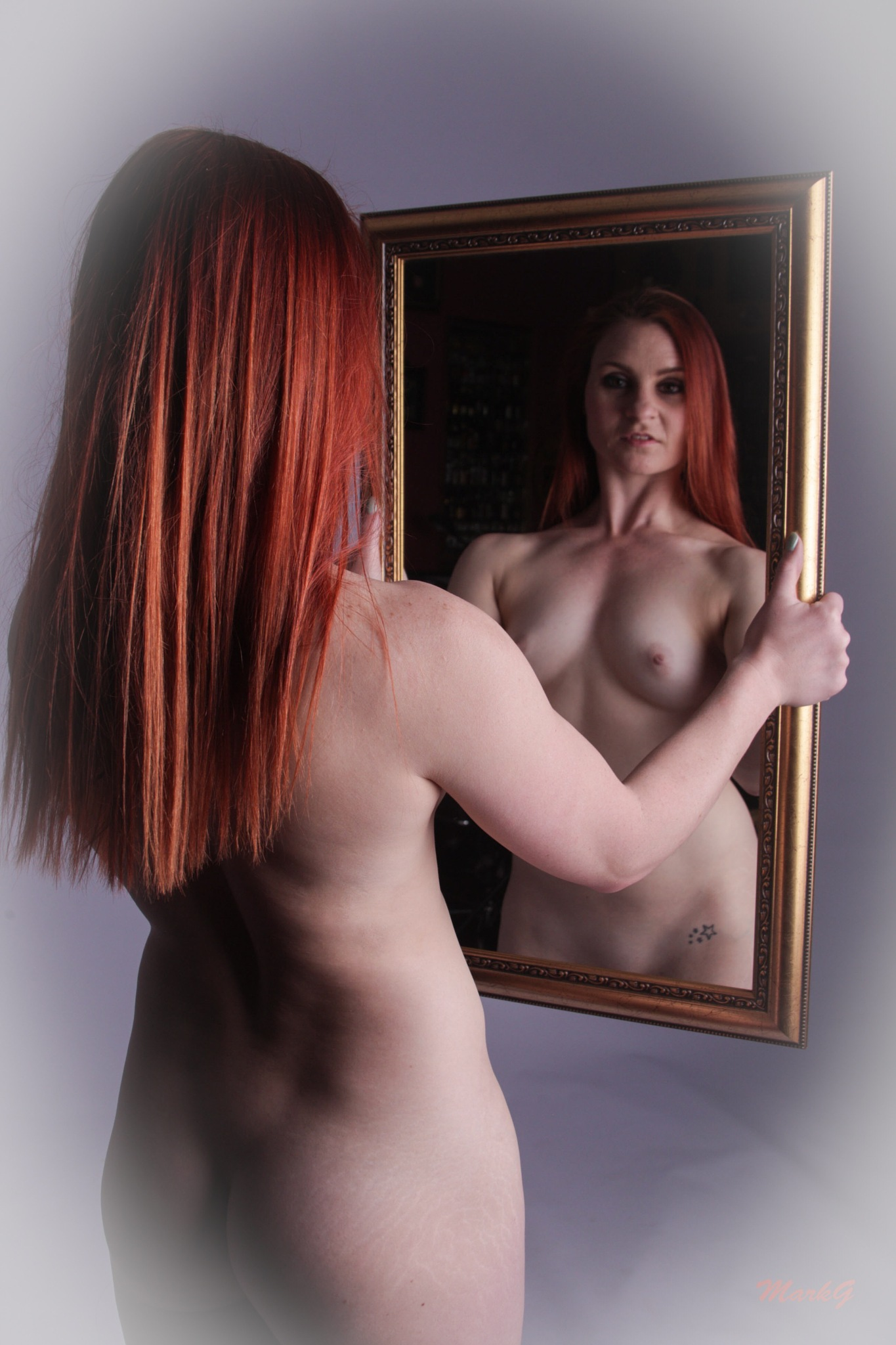 Alana in the mirror by Mark Greenslade