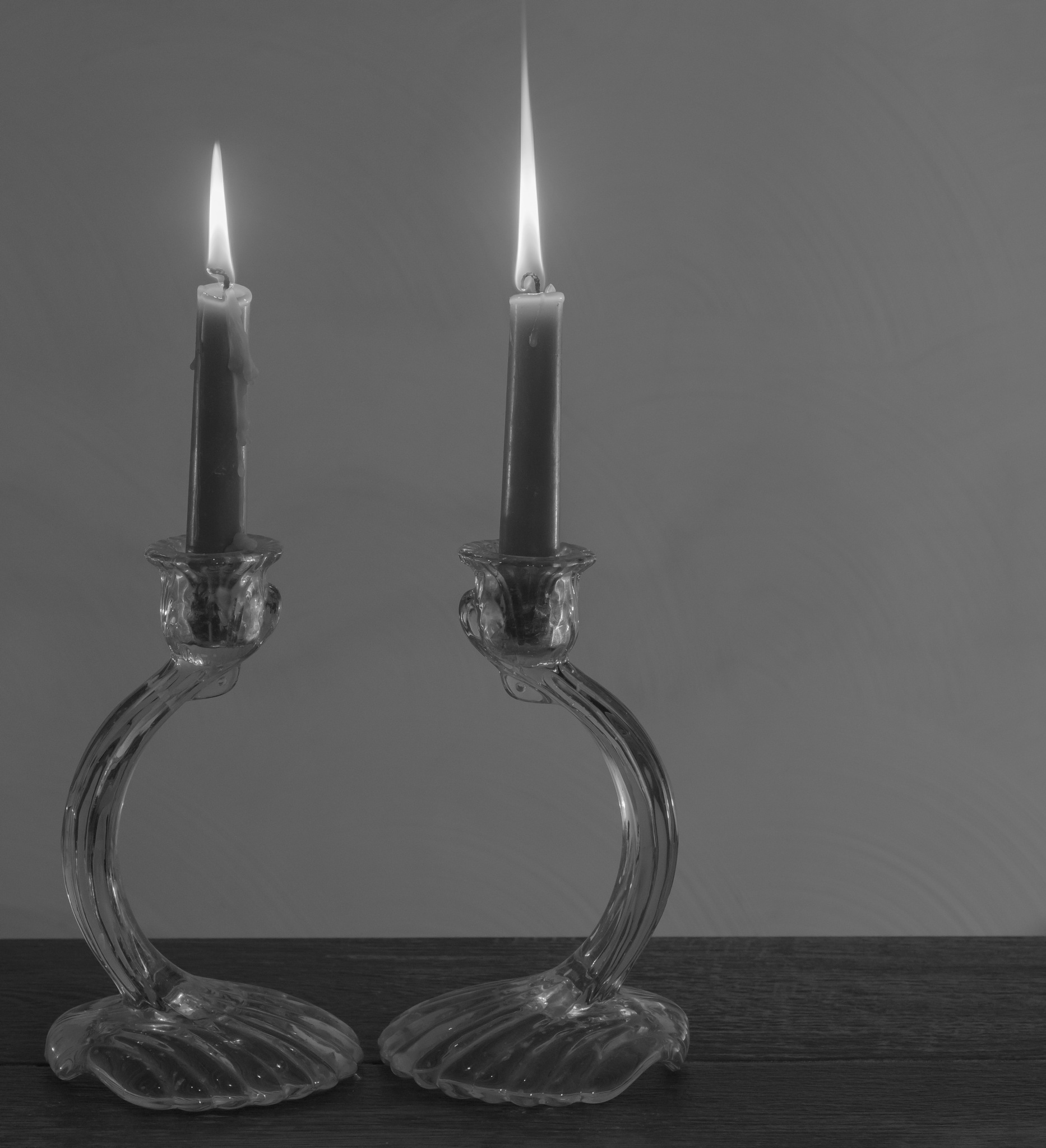 Two lit candles by Stephen Sepan