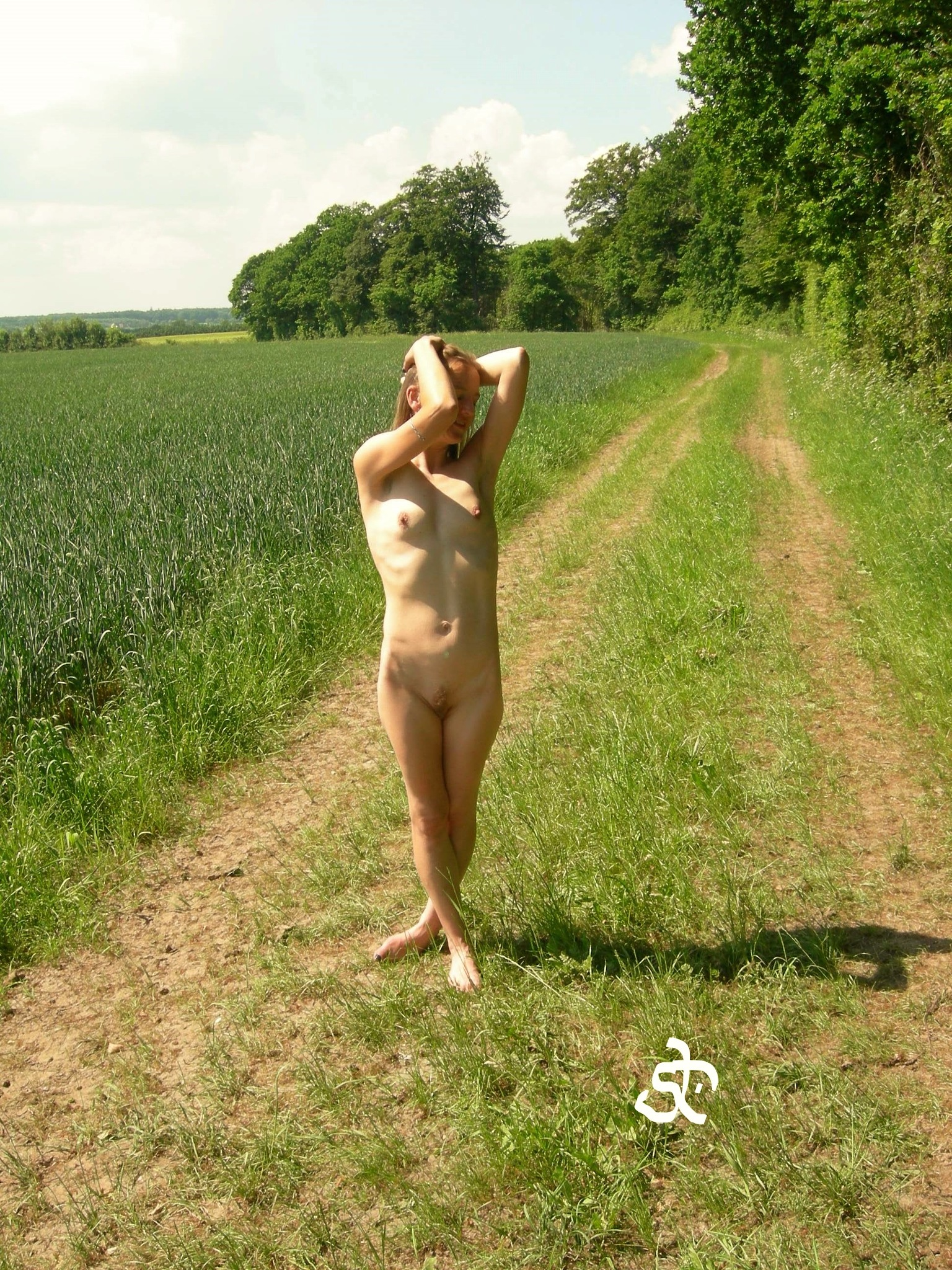 POSING ON THE FIELD ROAD. (0) by Joergen Hansen