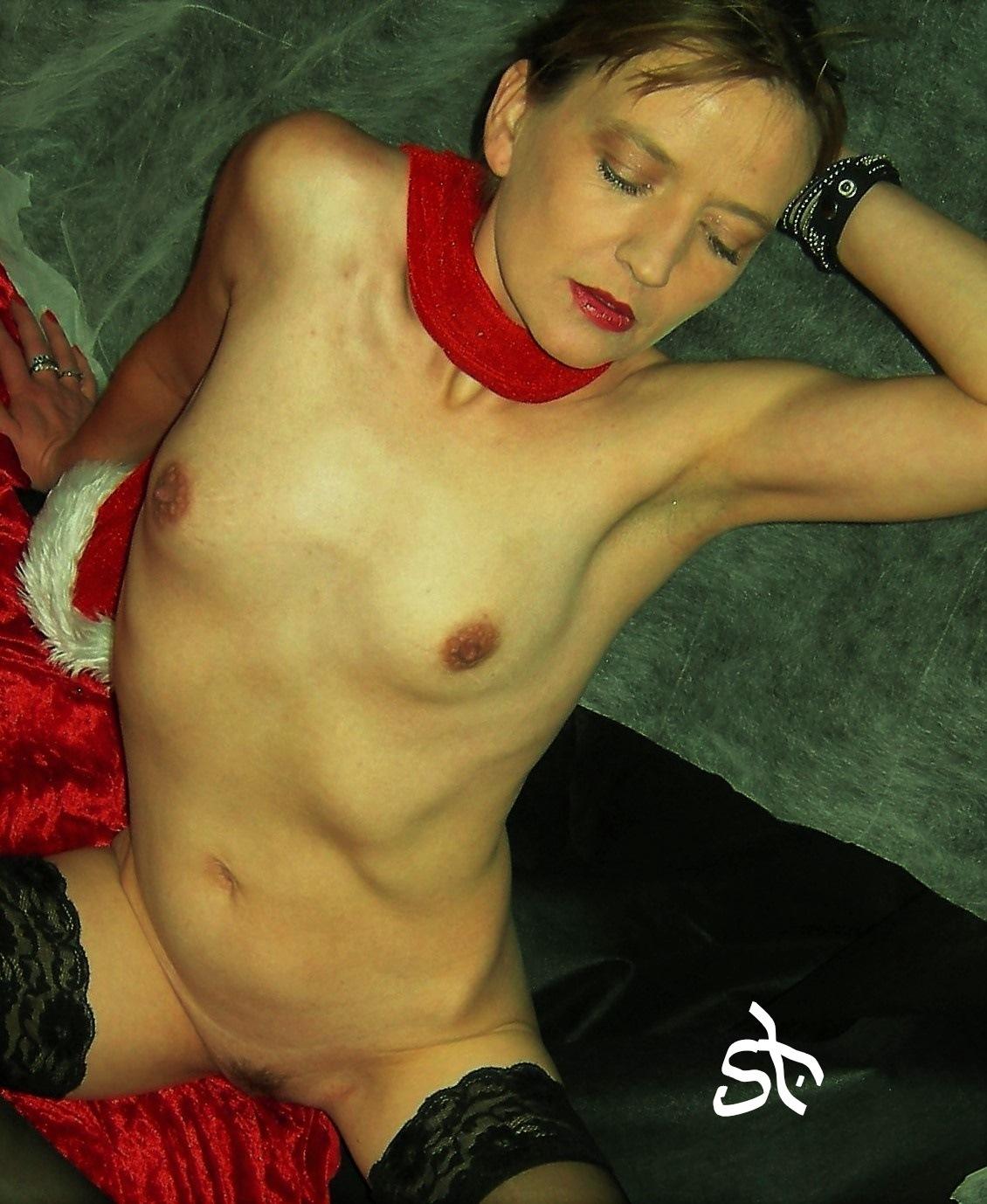 Santas helper posing nude. by Joergen Hansen