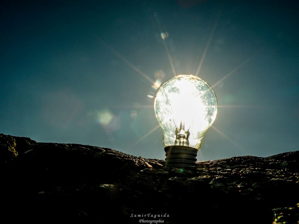 A lamp on a rock by Samir Taguida