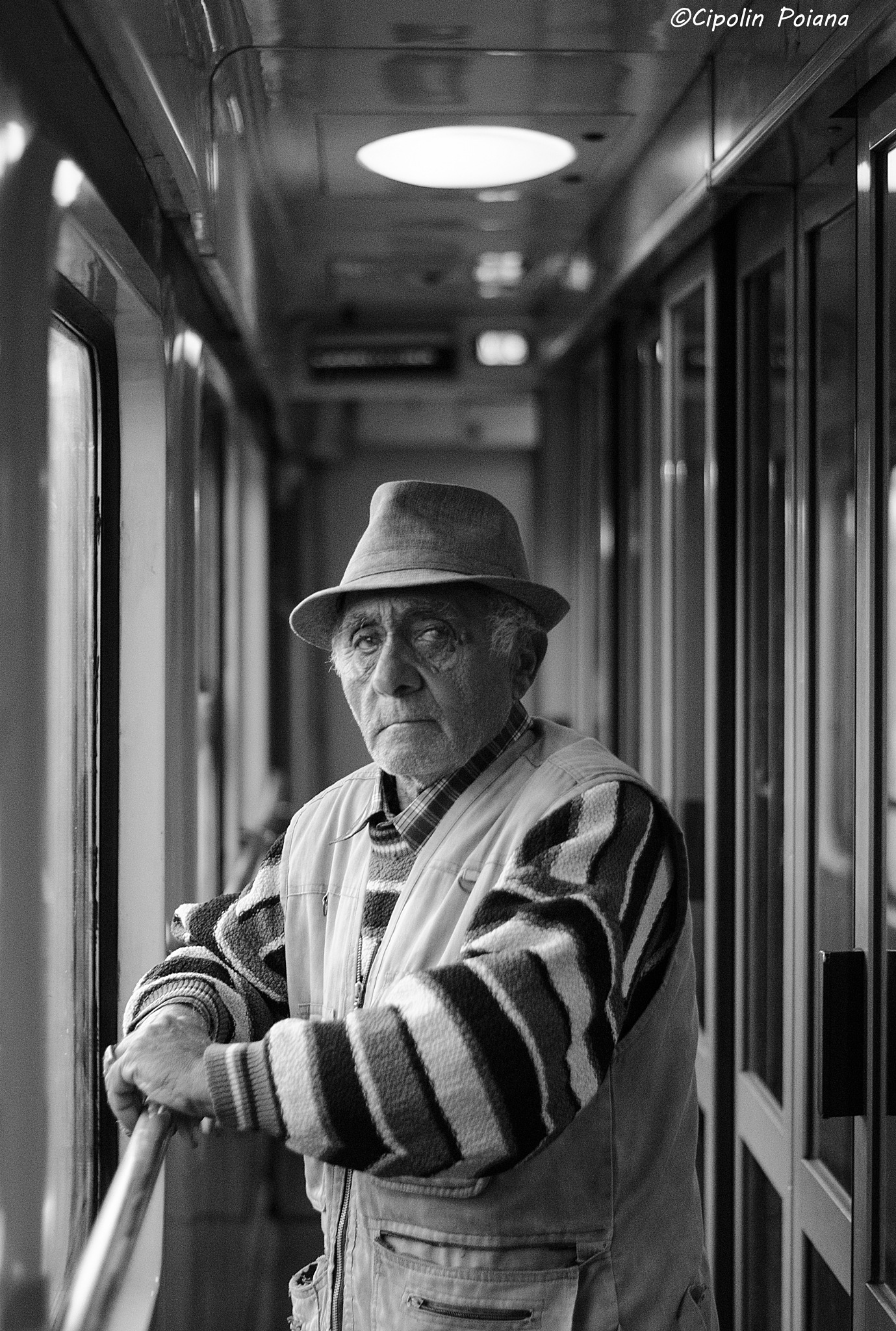 A old traveler with train by Poiana Cipolin