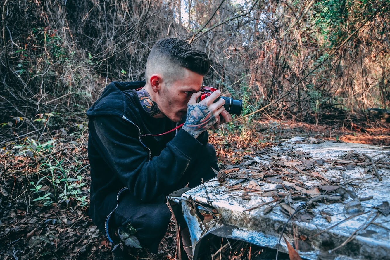 In the woods photographing old rusted junk  by Ashley Arnold