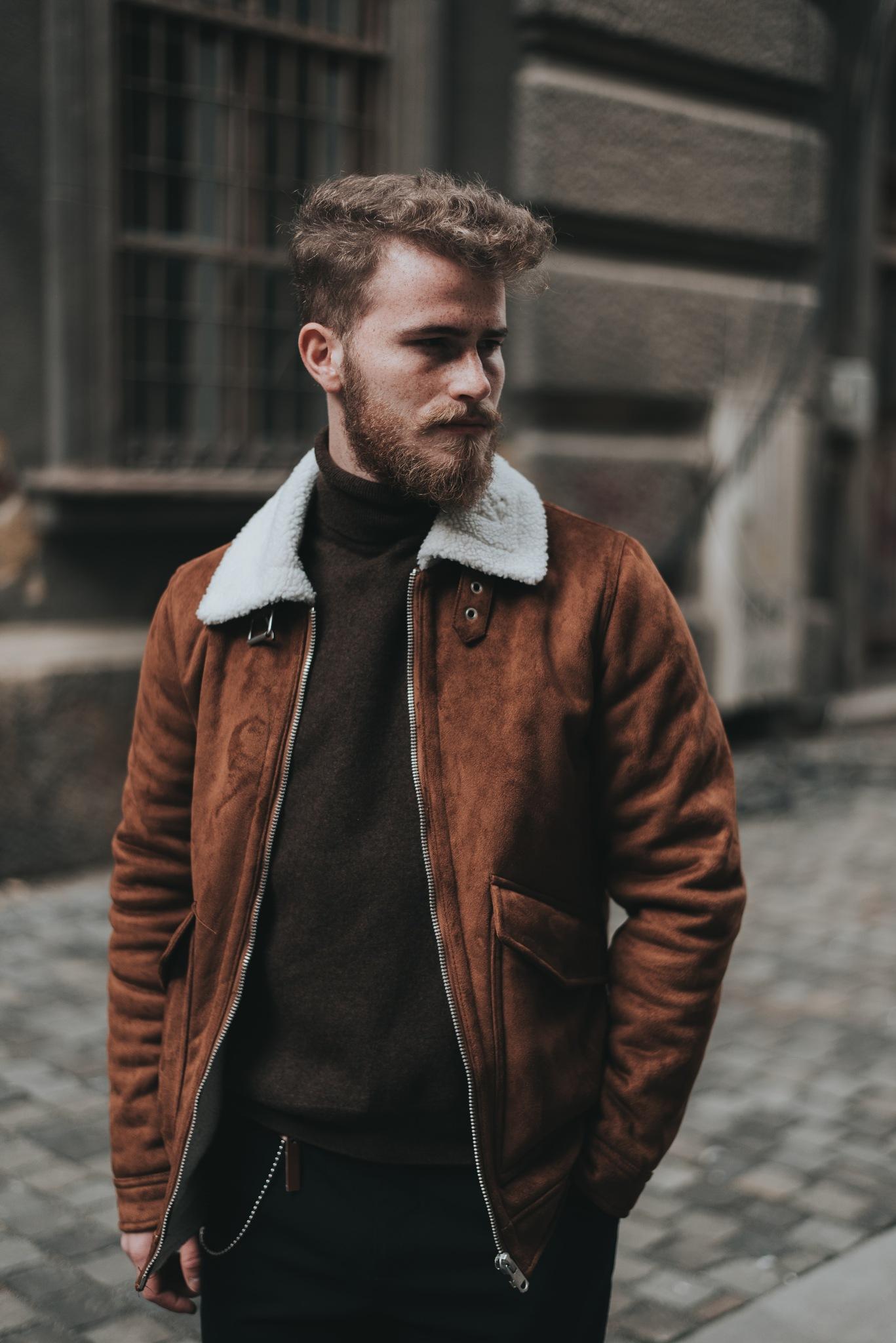 Man wearing a brown jacket by Skh Jr