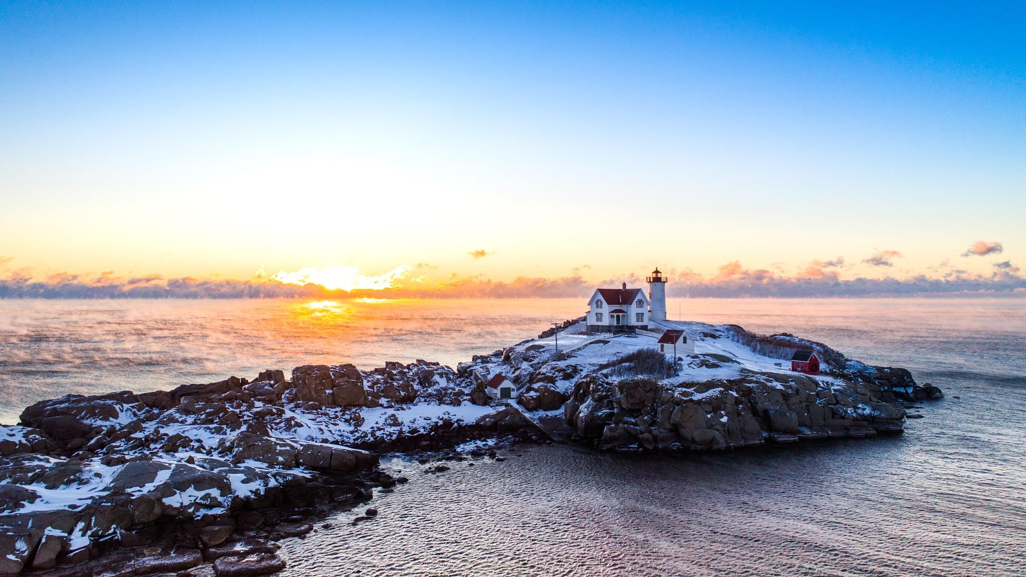 Sunrise at Nubble Lighthouse by HawkVisuals