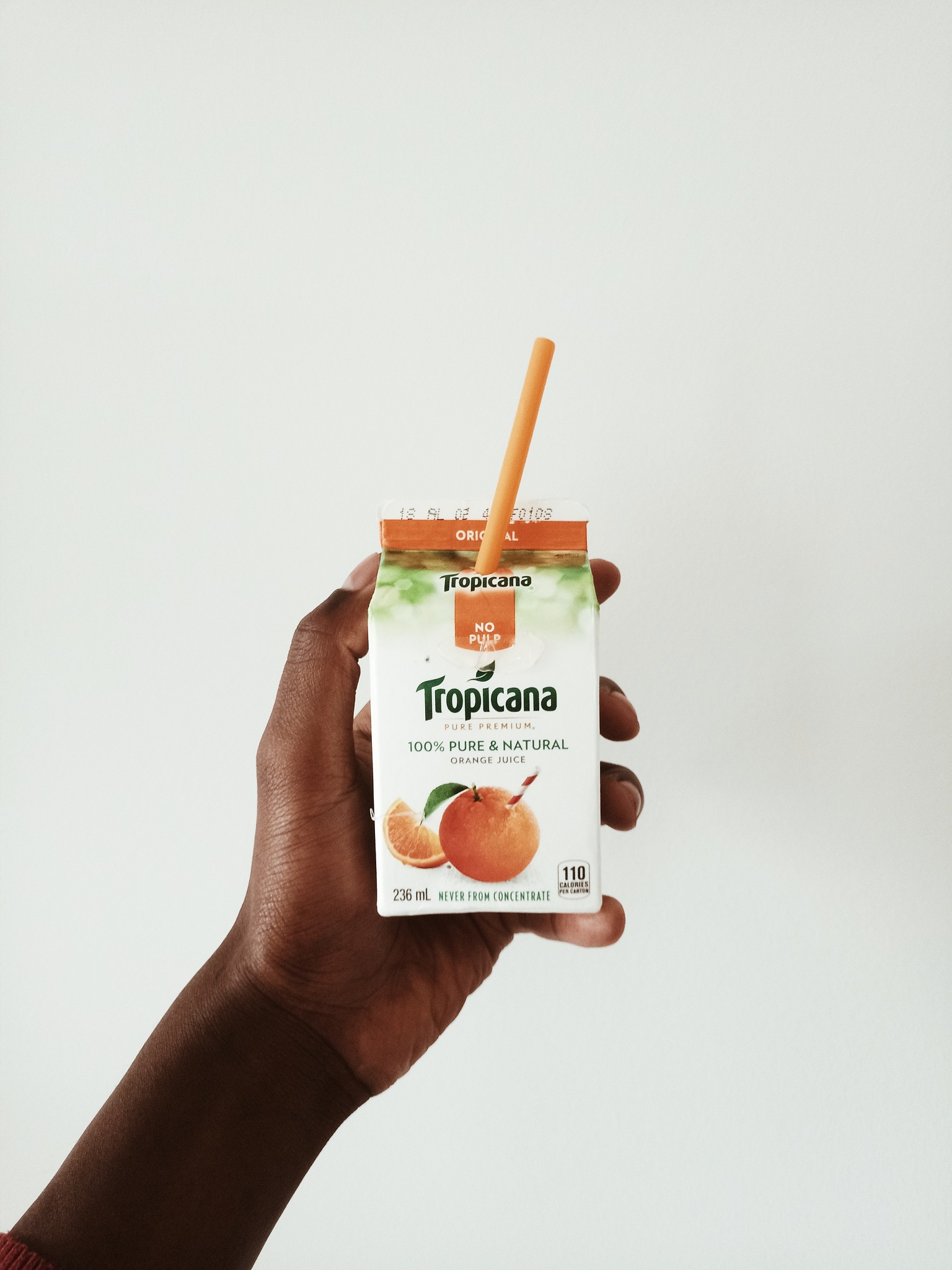 minimilast product shot of Tropicana juice box by FRED ANYONA