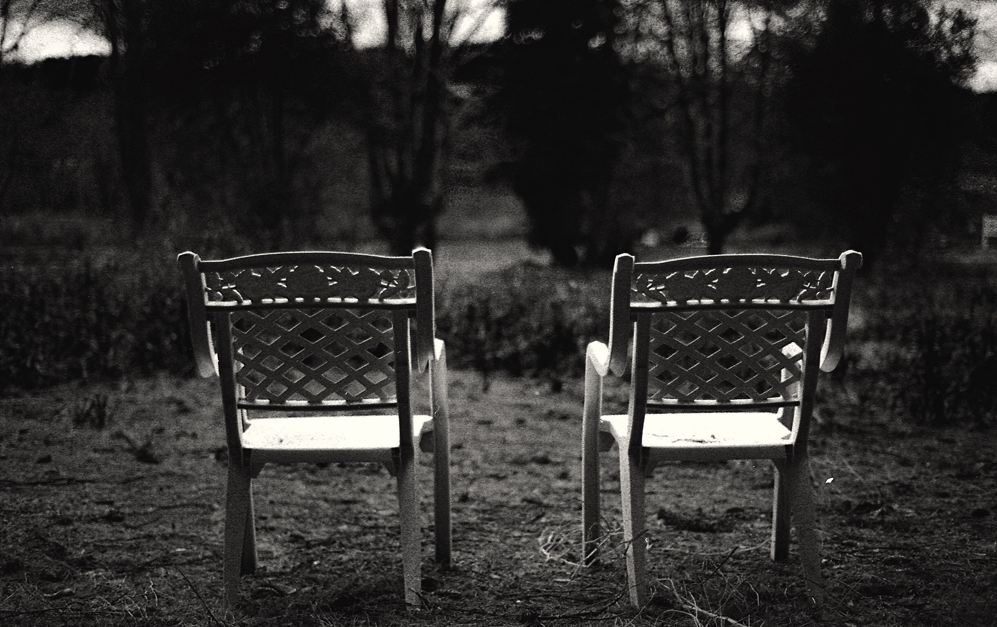 Two chairs in Ioco ghost town by Aydn Lunden