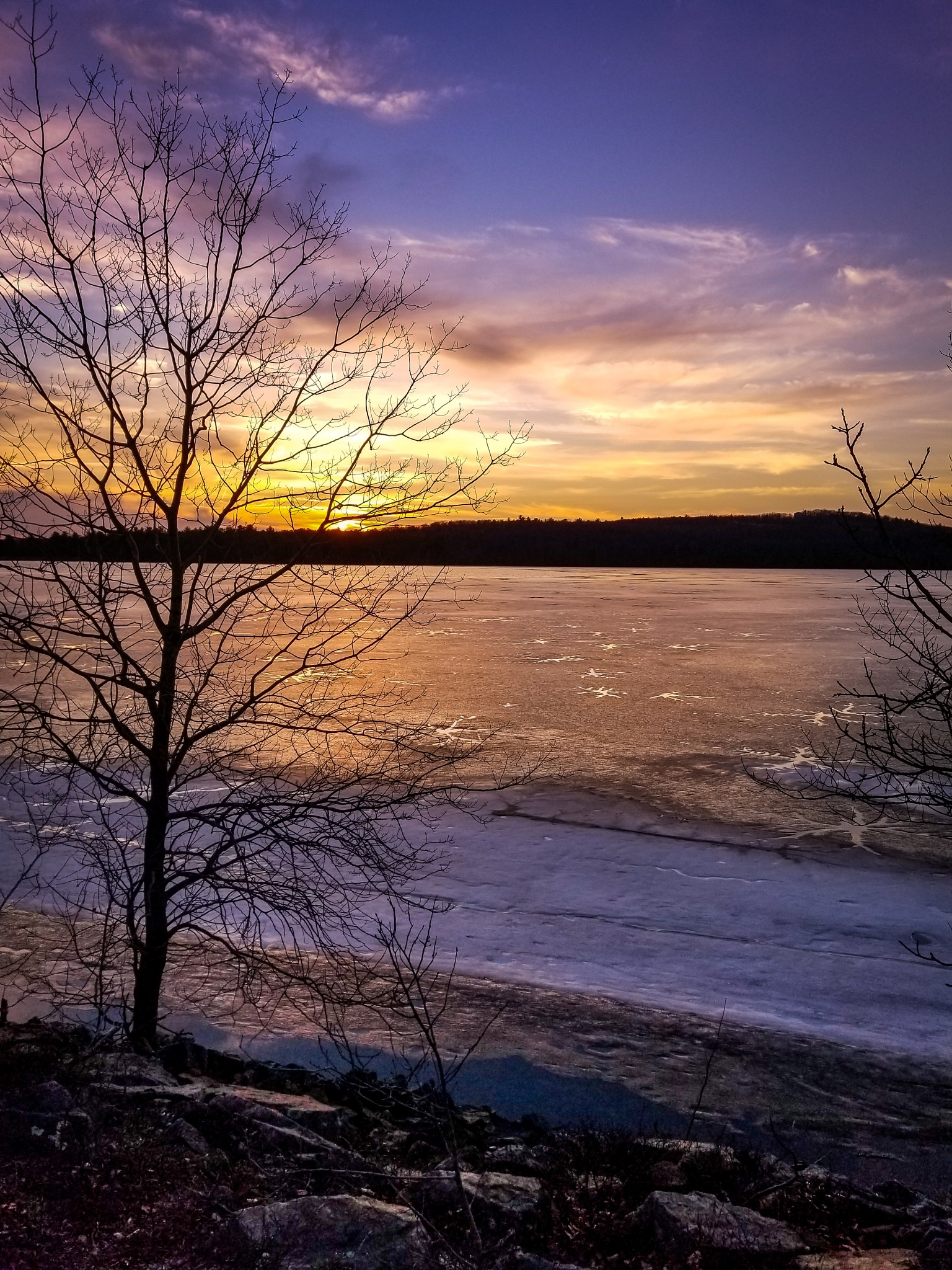 Sunset over a frozen lake by Mike Figueiredo