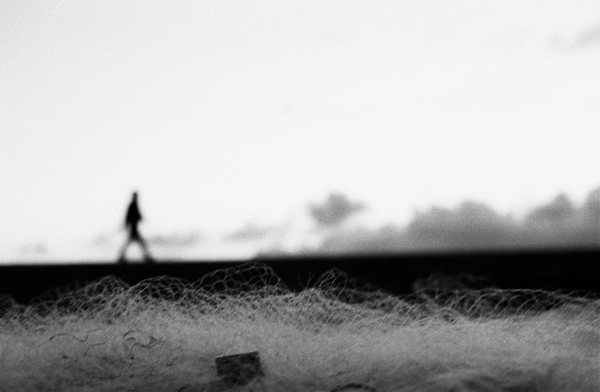 Fishing net and man by Jorge Eduardo Gordillo Santos