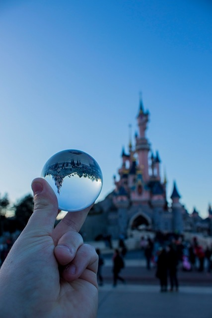 look at disney with a glass ball by Tayler Bate