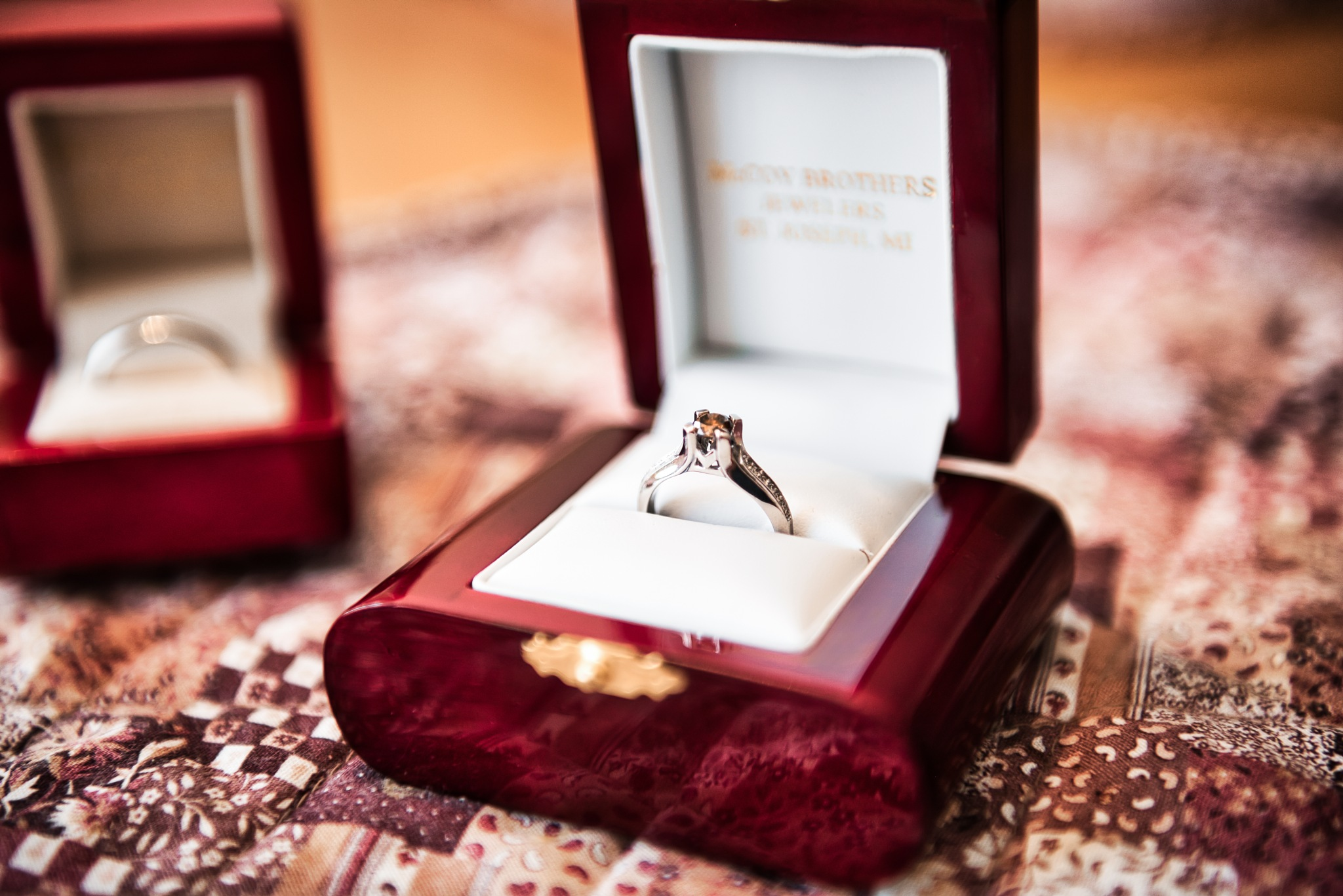 Engagement Rings in Their Boxes by Jonathan Swerdlow