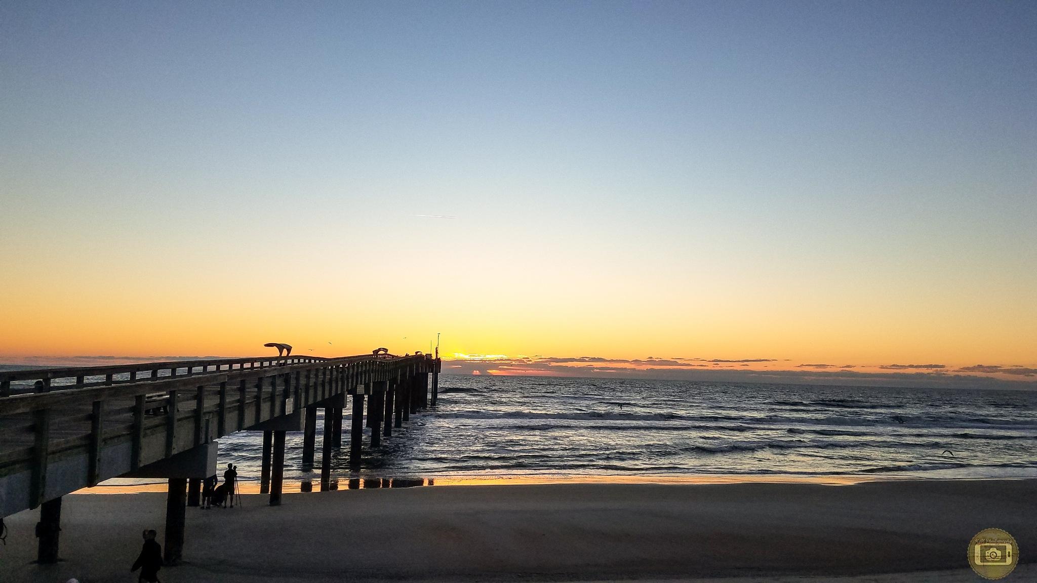 Sunrise at Saint Augustine Beach pier  by KMPhotography