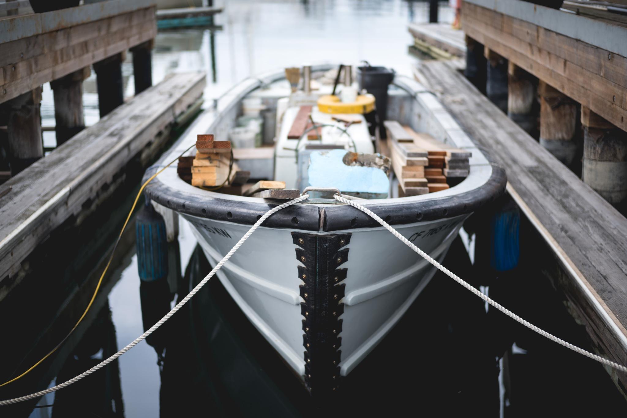Boat full of junk  by James Wilkinson