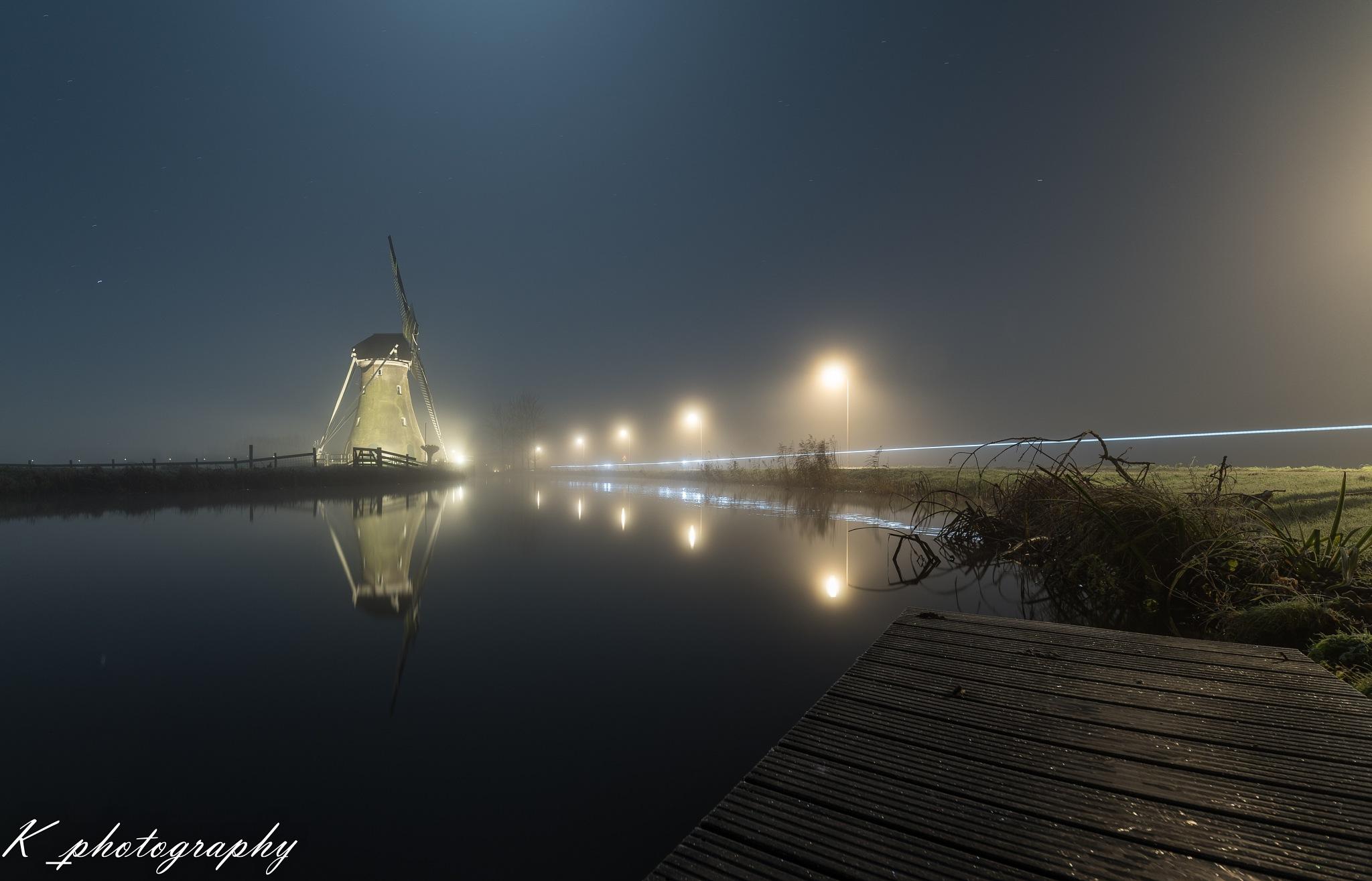 windmill in the fog. by Koen Lourier