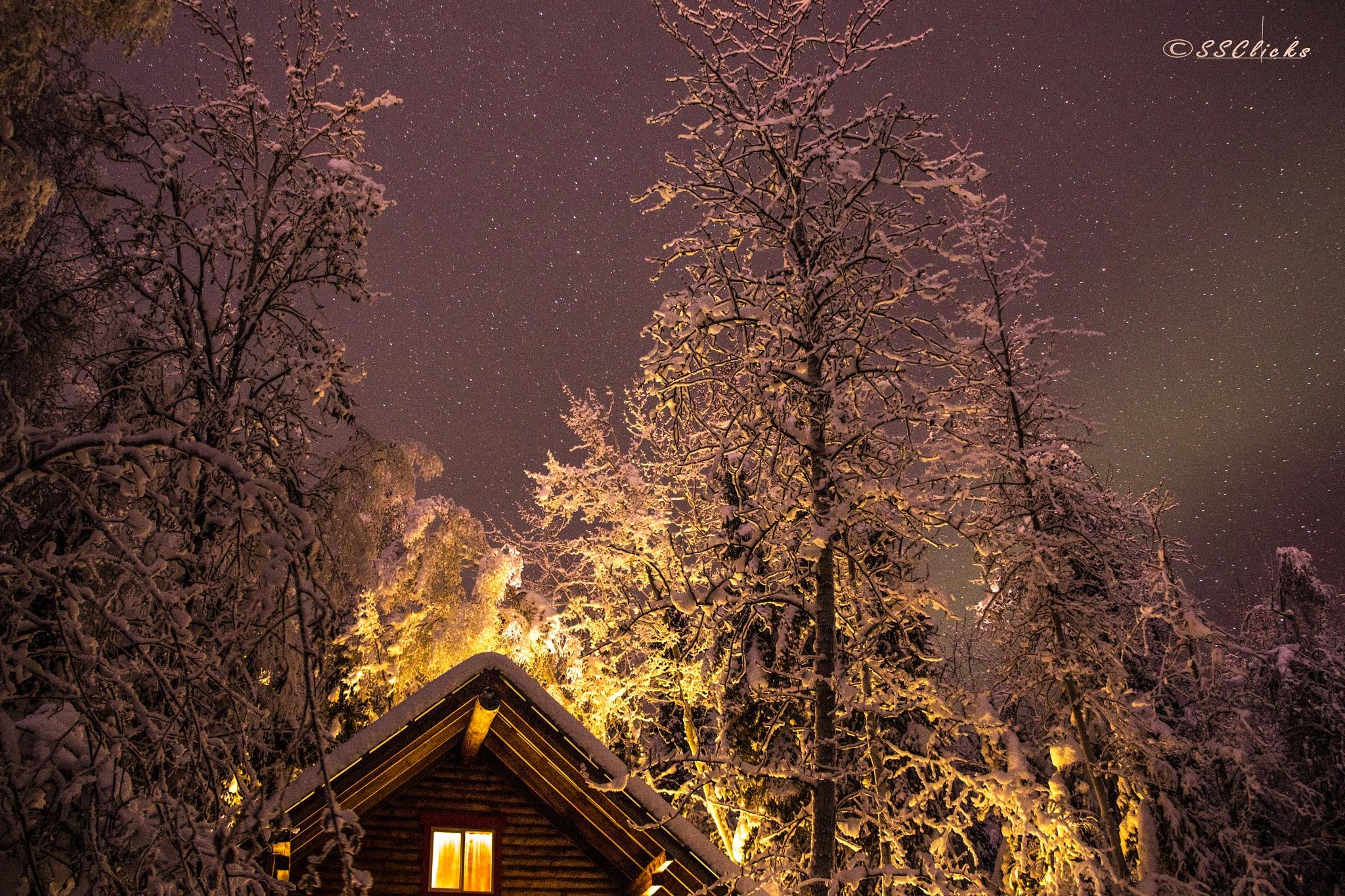 Stars and cabin by Sriram Areti